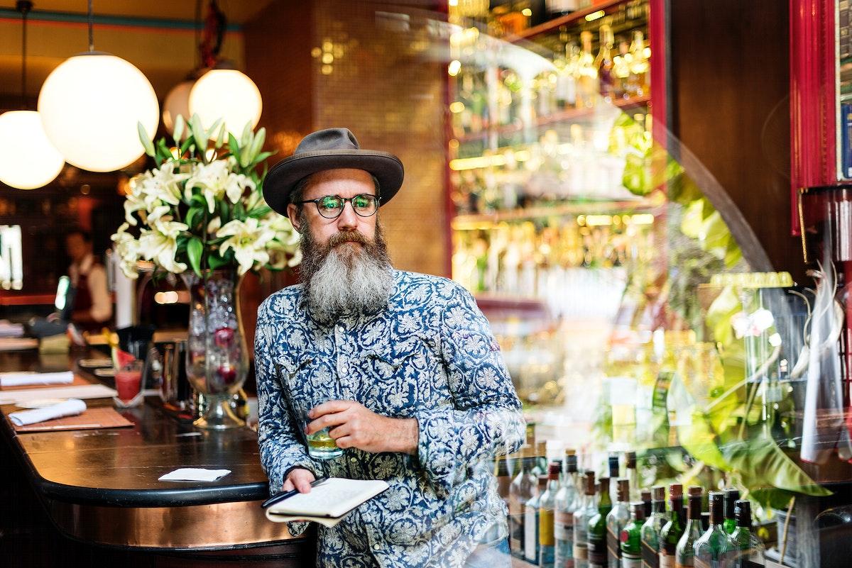 A man taking notes at a bar