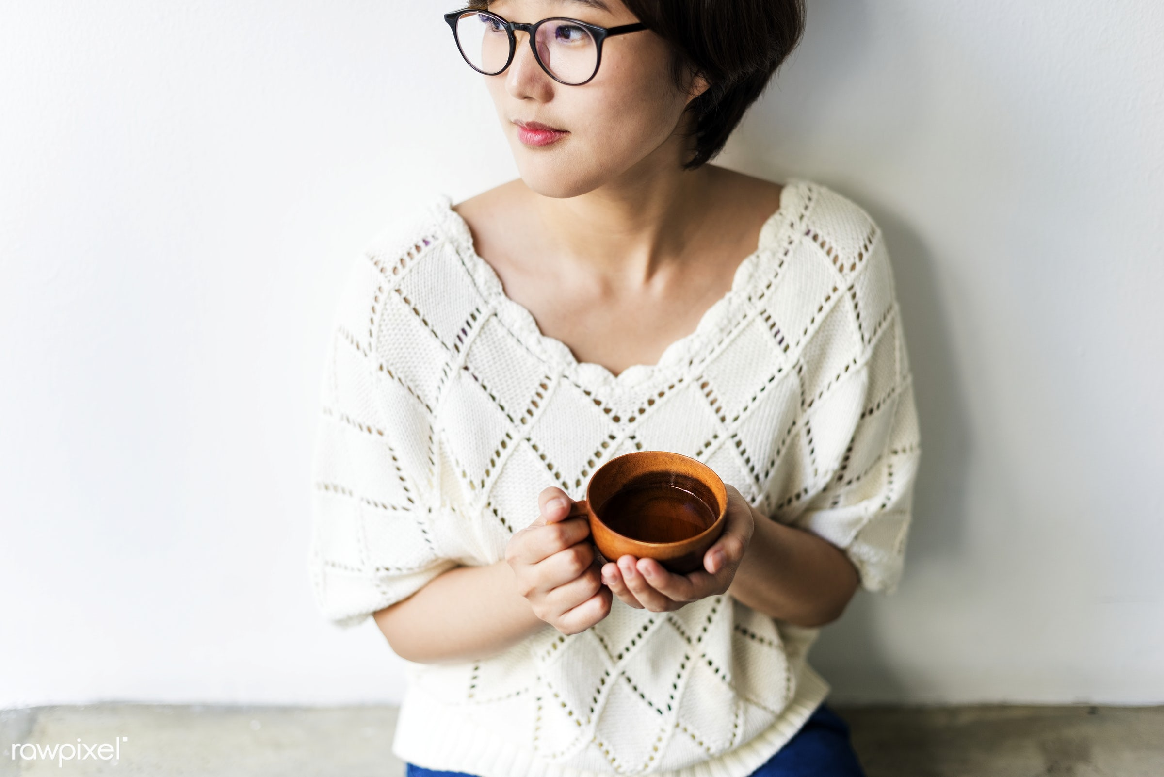 An Asian woman enjoying her cup of tea - asian, thinking, teenager, tea, cafe, adult, aroma, attractive, beautiful, beauty,...
