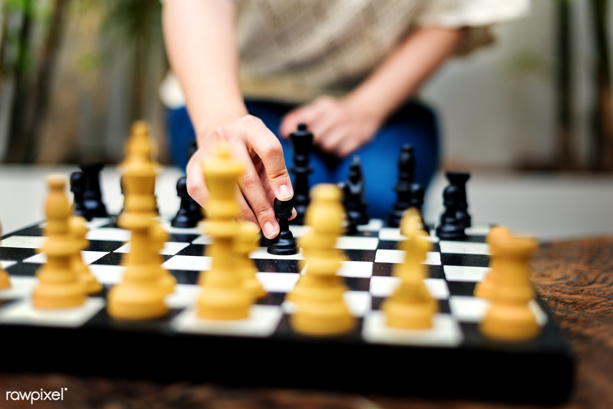 A woman playing a chess. - chess, mission, objective, process, activity, amusement, analyse, brain, business, creative,...