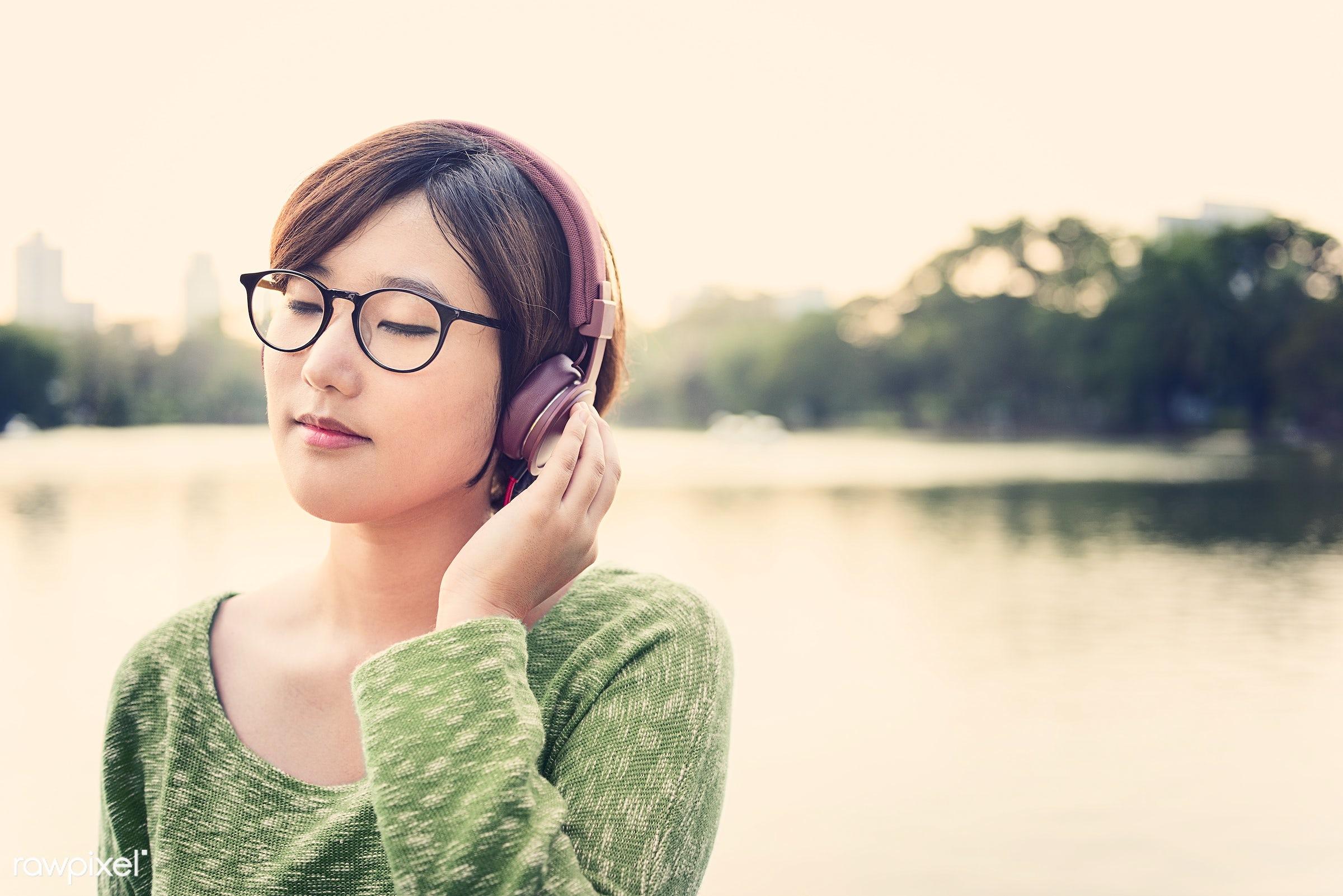 activity, asian ethnicity, audio equipment, calm, casual, chilling, earphones, electronic, enjoyment, entertainment,...