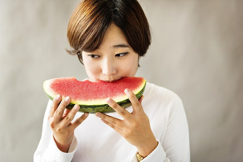 Asian Girl Eating Watermelon Fruit Sweet Dessert Concept