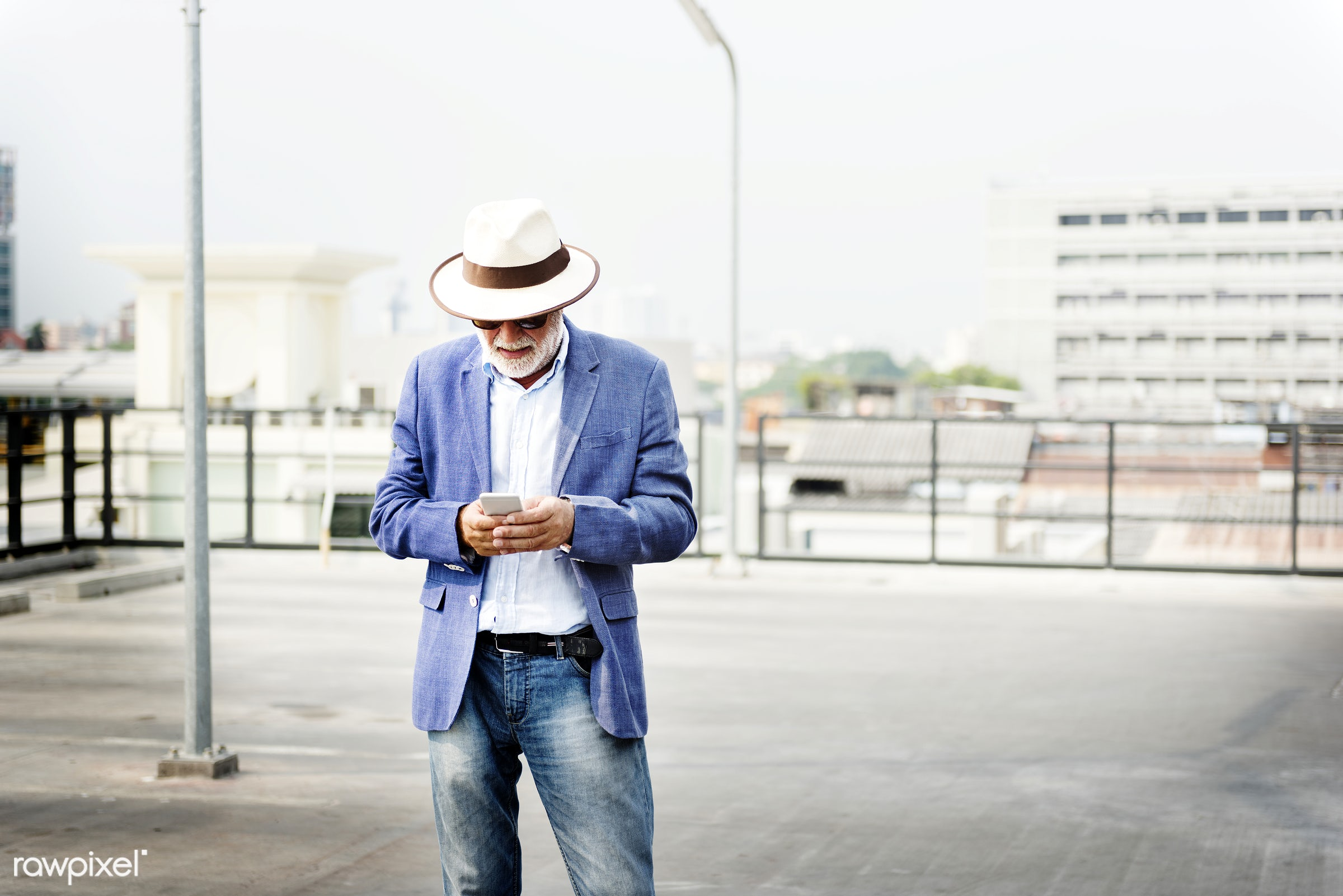 Elderly man is using mobile phone - elderly, hipster, beard, alone, casual, cellphone, communication, connection, device,...