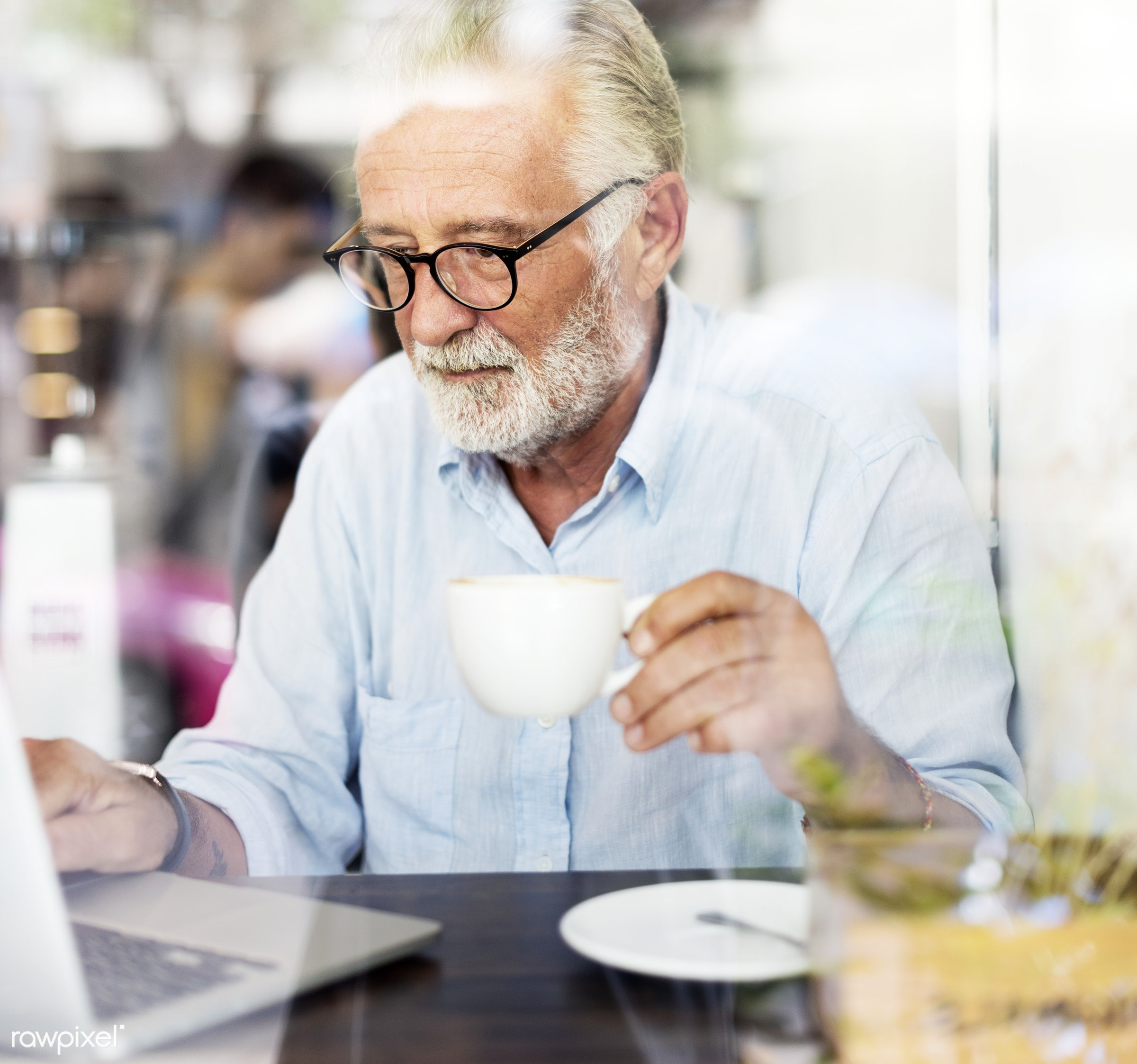Elderly man is using computer laptop - alone, beard, casual, coffee shop, communication, computer, connection, device,...