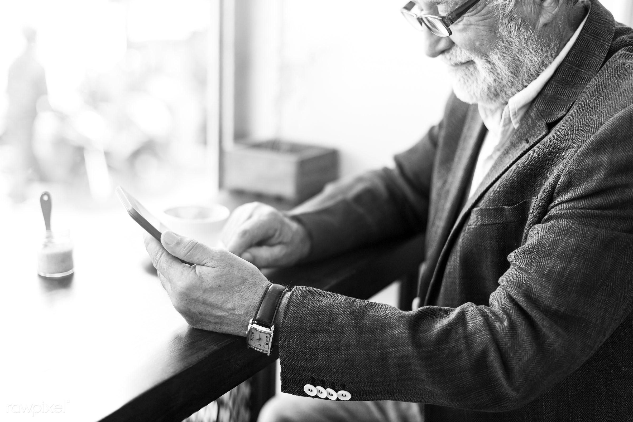 Elderly man is using digital tablet - alone, beard, casual, caucasian, communication, connection, device, digital, elderly,...