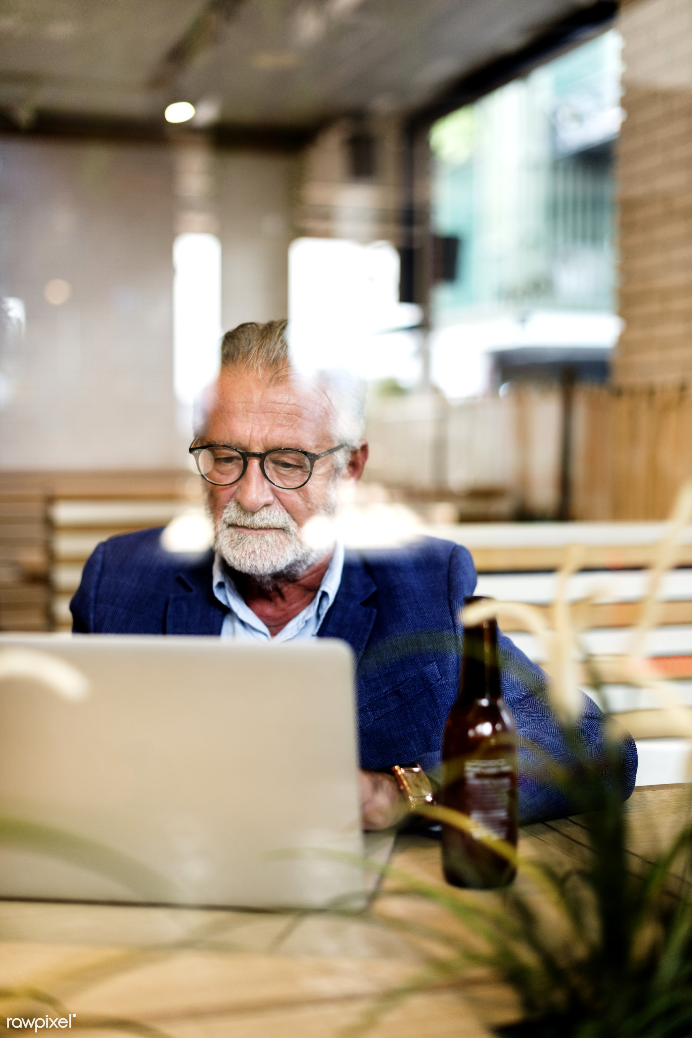 Elderly man is using computer laptop - alone, casual, coffee shop, communication, computer, connection, device, digital,...