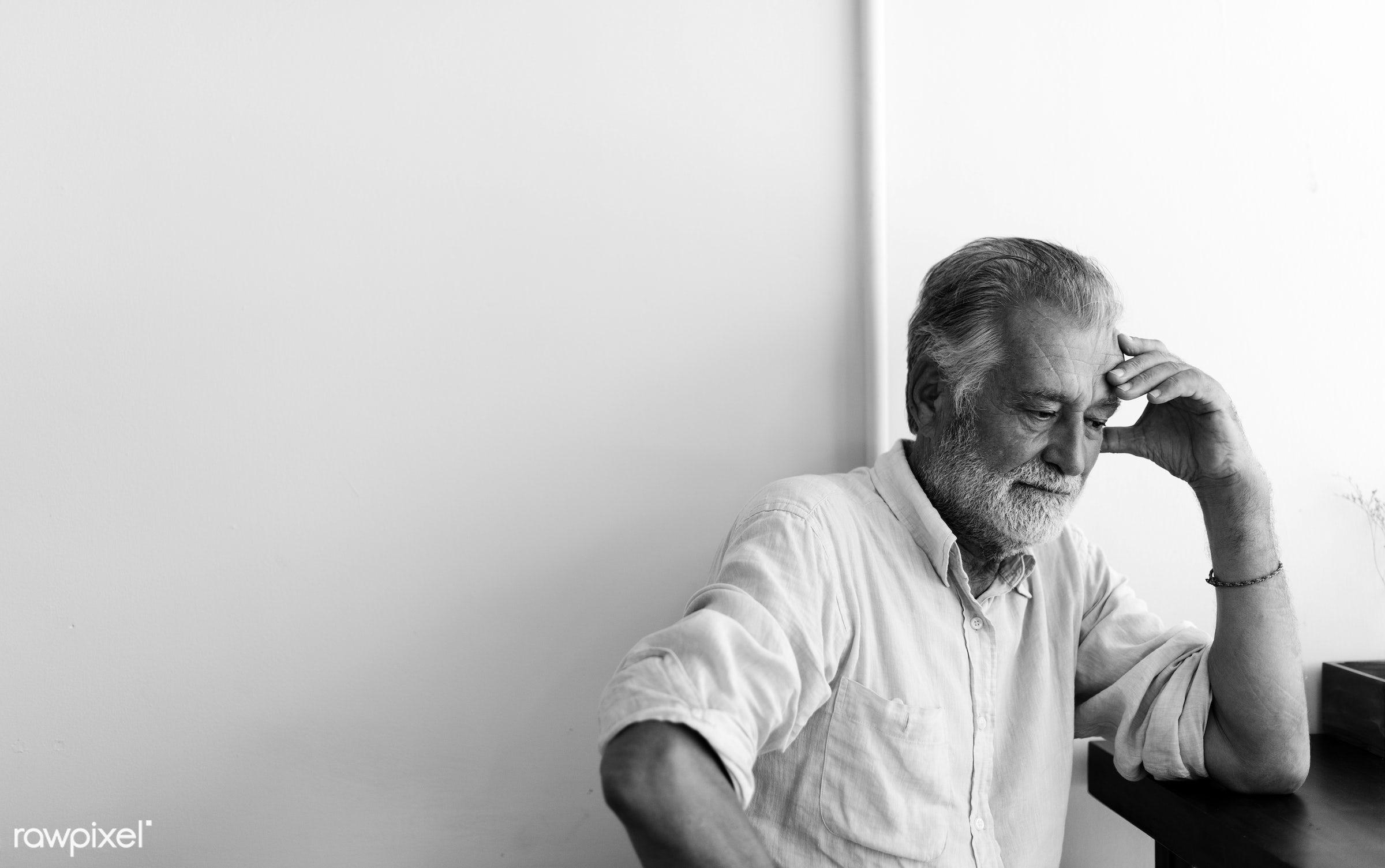 Elderly man is sitting thoughtfully - alone, beard, black and white, caucasian, depressed, elderly, emotion, expression,...