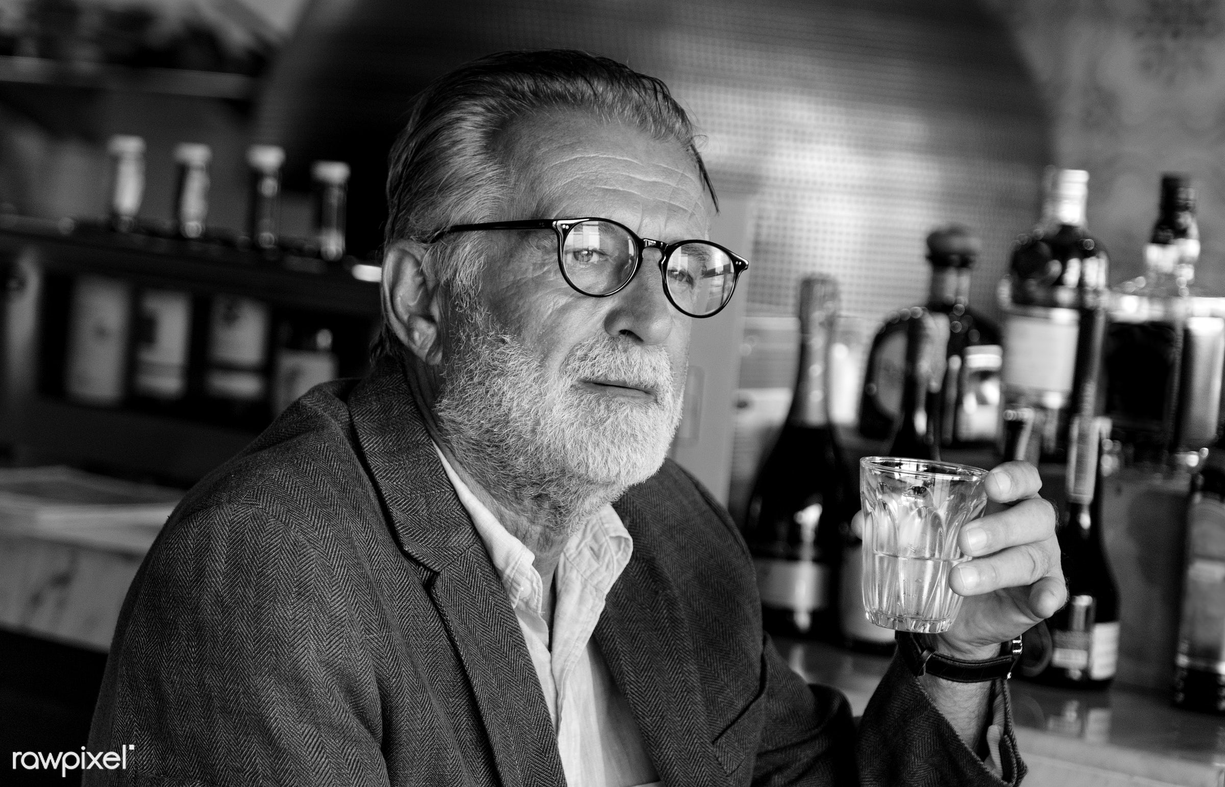 Elderly man is sitting in a pub - alone, bar, beard, beverage, casual, depressed, drink, elderly, emotion, expression, face...