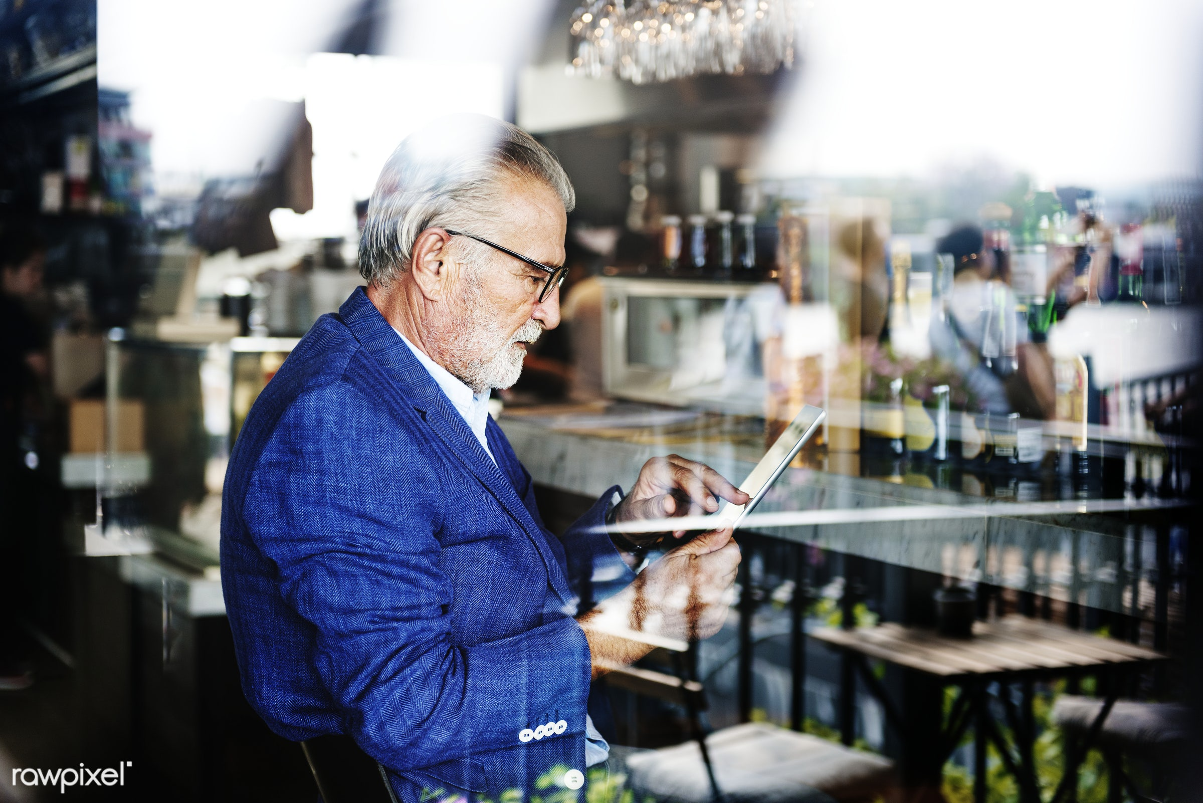 Elderly man is using digital tablet - alone, beard, casual, cellphone, communication, connection, device, digital, elderly,...