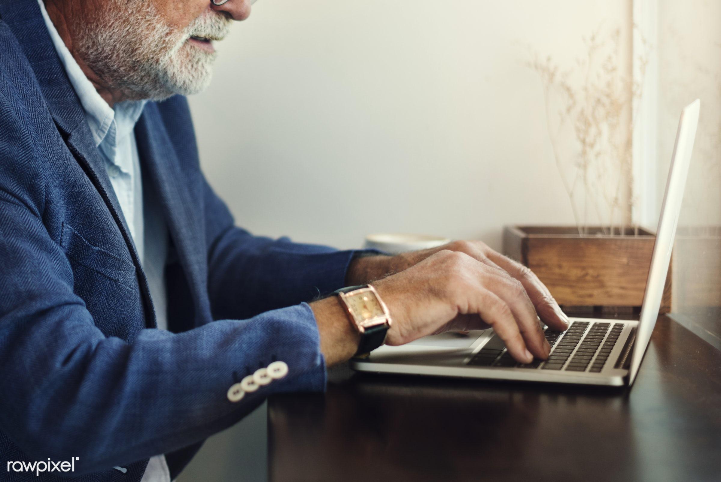 Elderly man is using computer laptop - computer, elderly, working, shop, coffee shop, man, news, work, website, leisure,...
