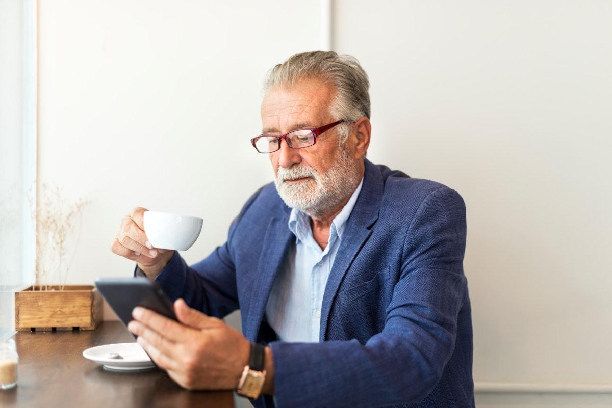 Elderly man is using digital tablet