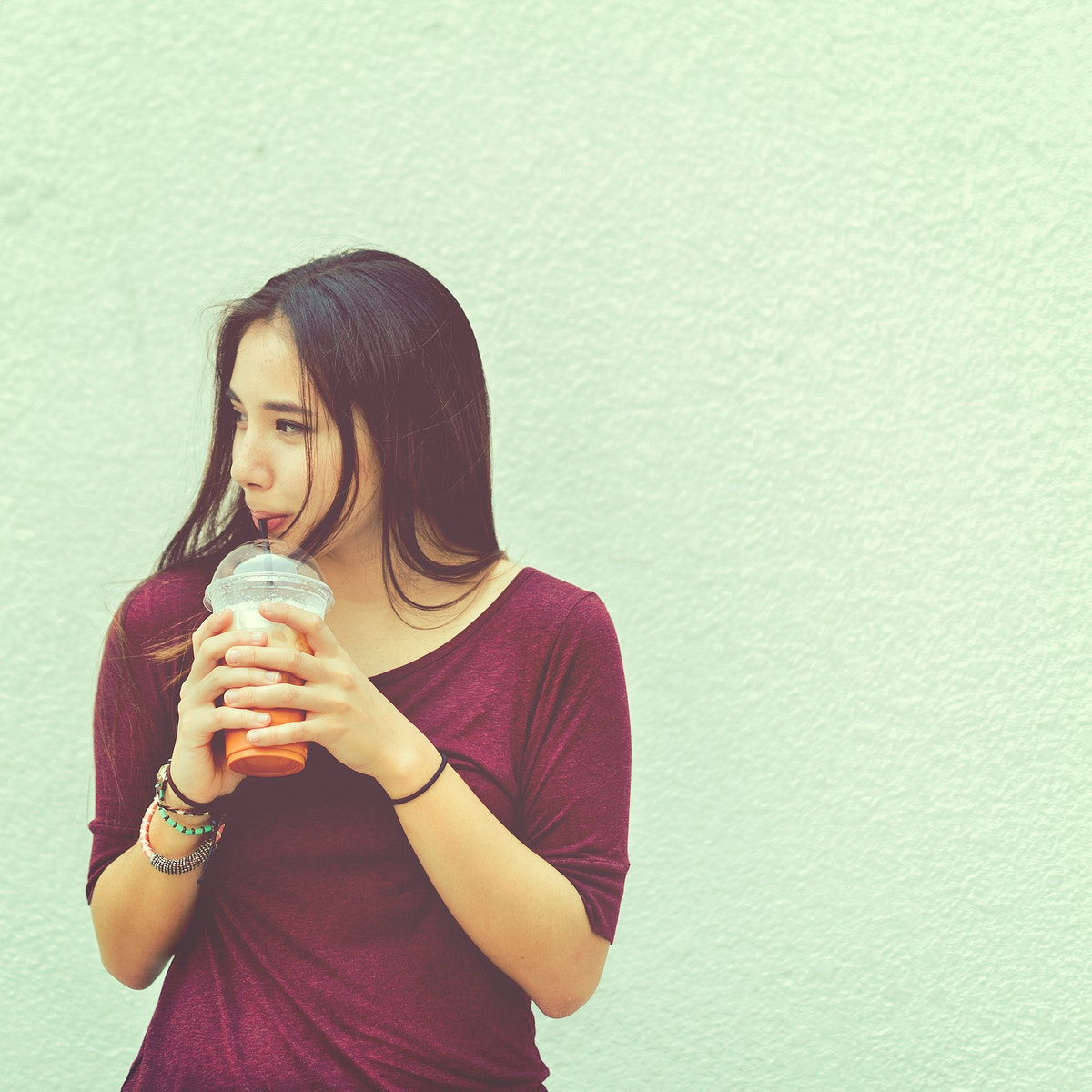 Young woman drinking milk tea