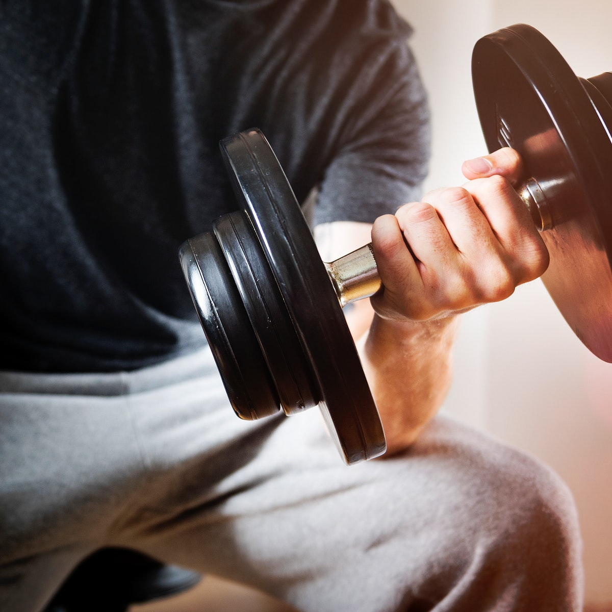 Closeup of hand holding barbell weight training