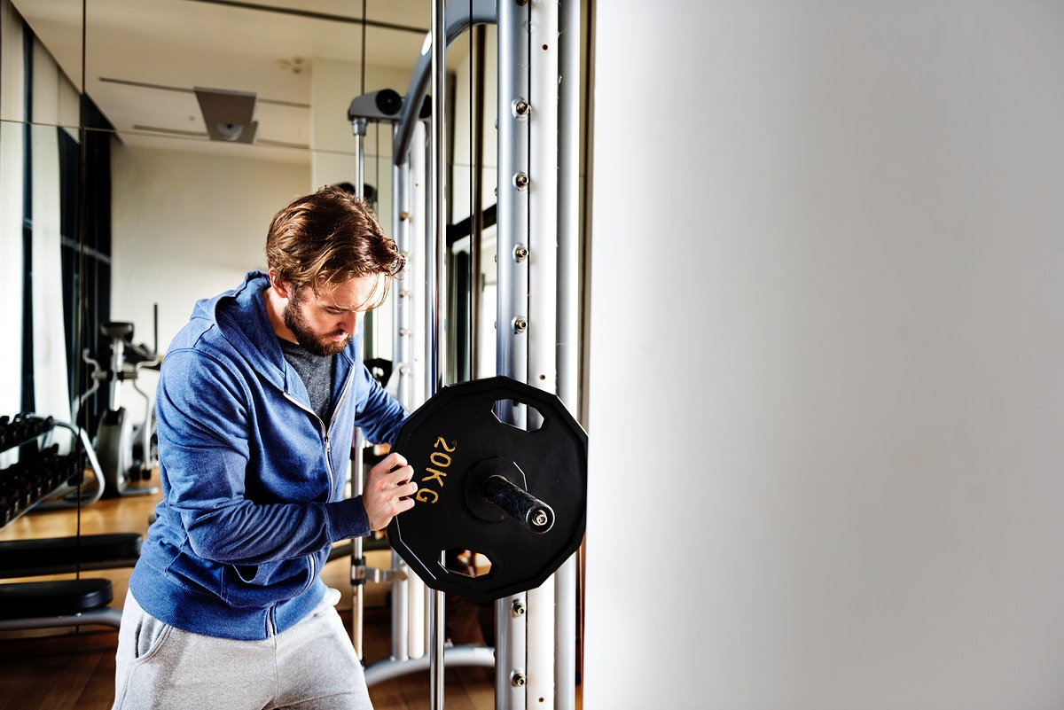 A man lifting weights in the gym