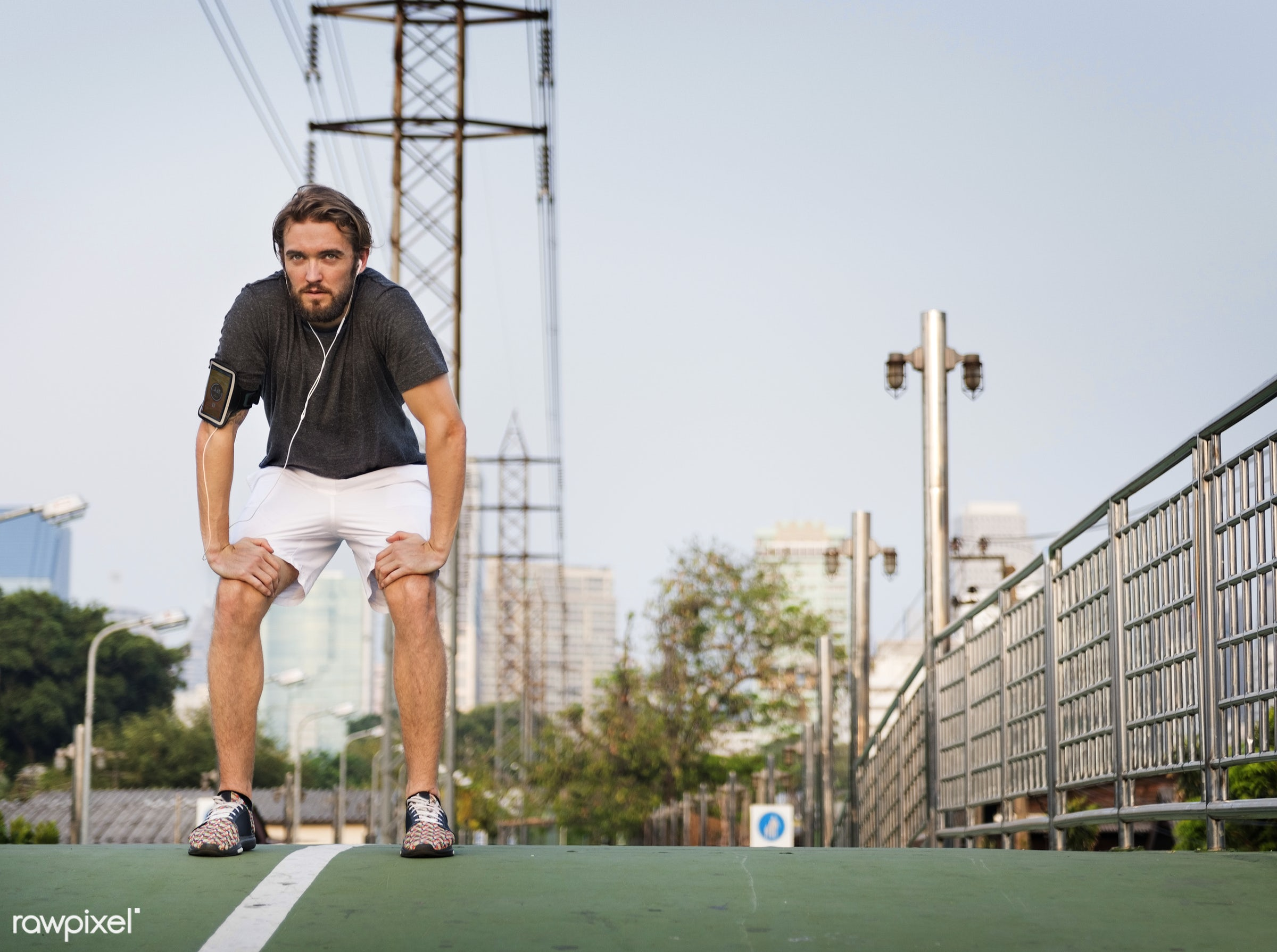 A man working out in the city - athlete, bangkok, active, adult, athletic, attractive, city, cool down, exercise, exercising...
