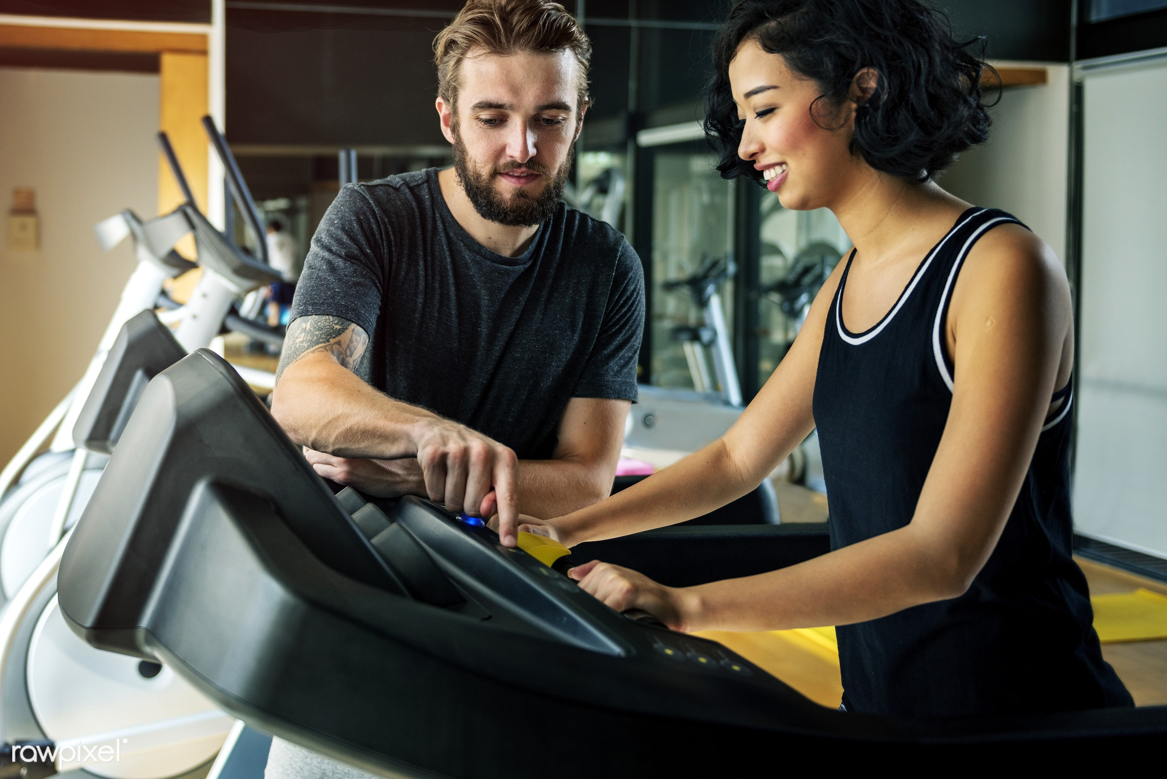 Couple working out together at the gym - fitness, workout, sport, trainer, leisure, wellness, active, adult, asian, athlete...