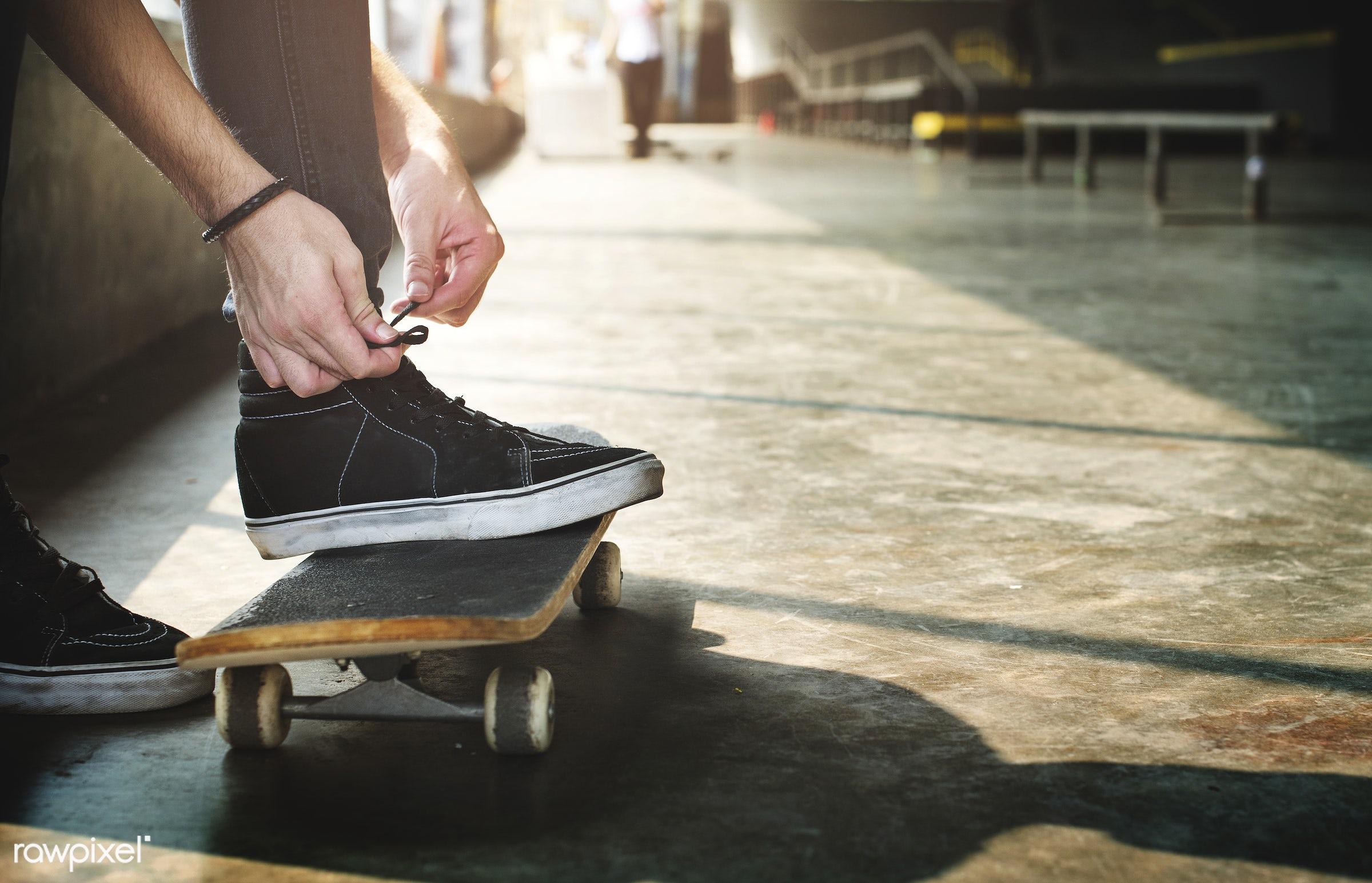 shoes, extreme sport, tying, hobby, feet, leisure, skateboard, robe, skatepark, hands, sneakers, alone, closeup