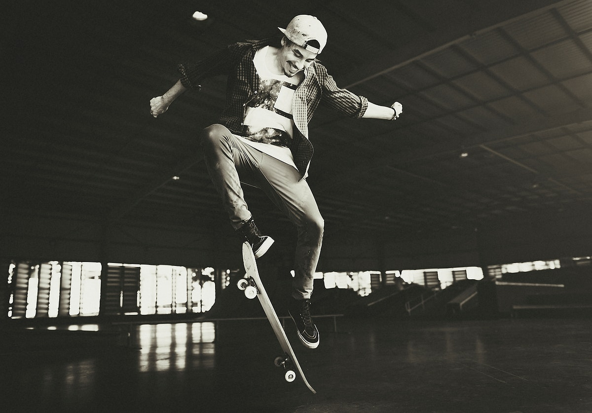 Man playing skateboard with jumping ollie