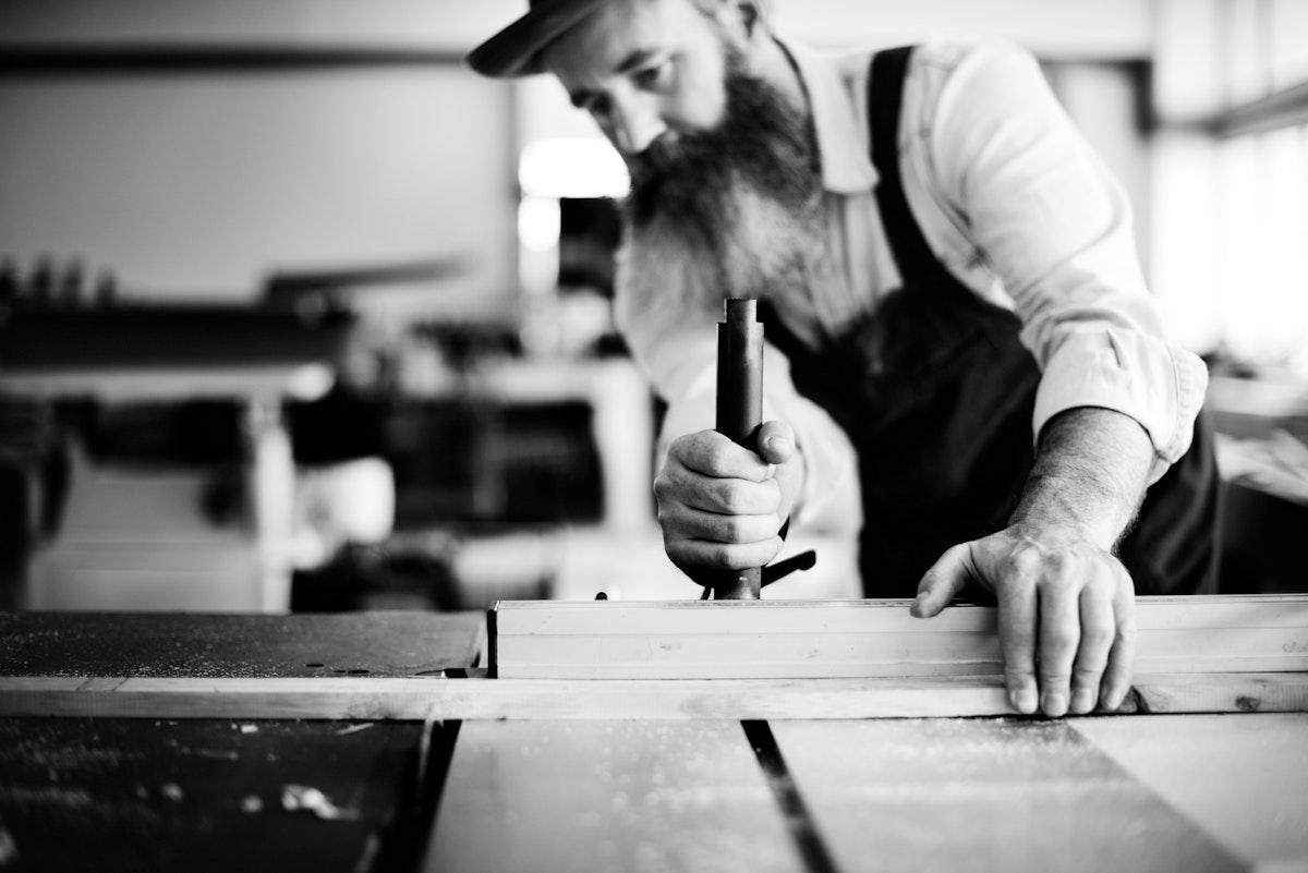 Carpenter working in workshop grayscale