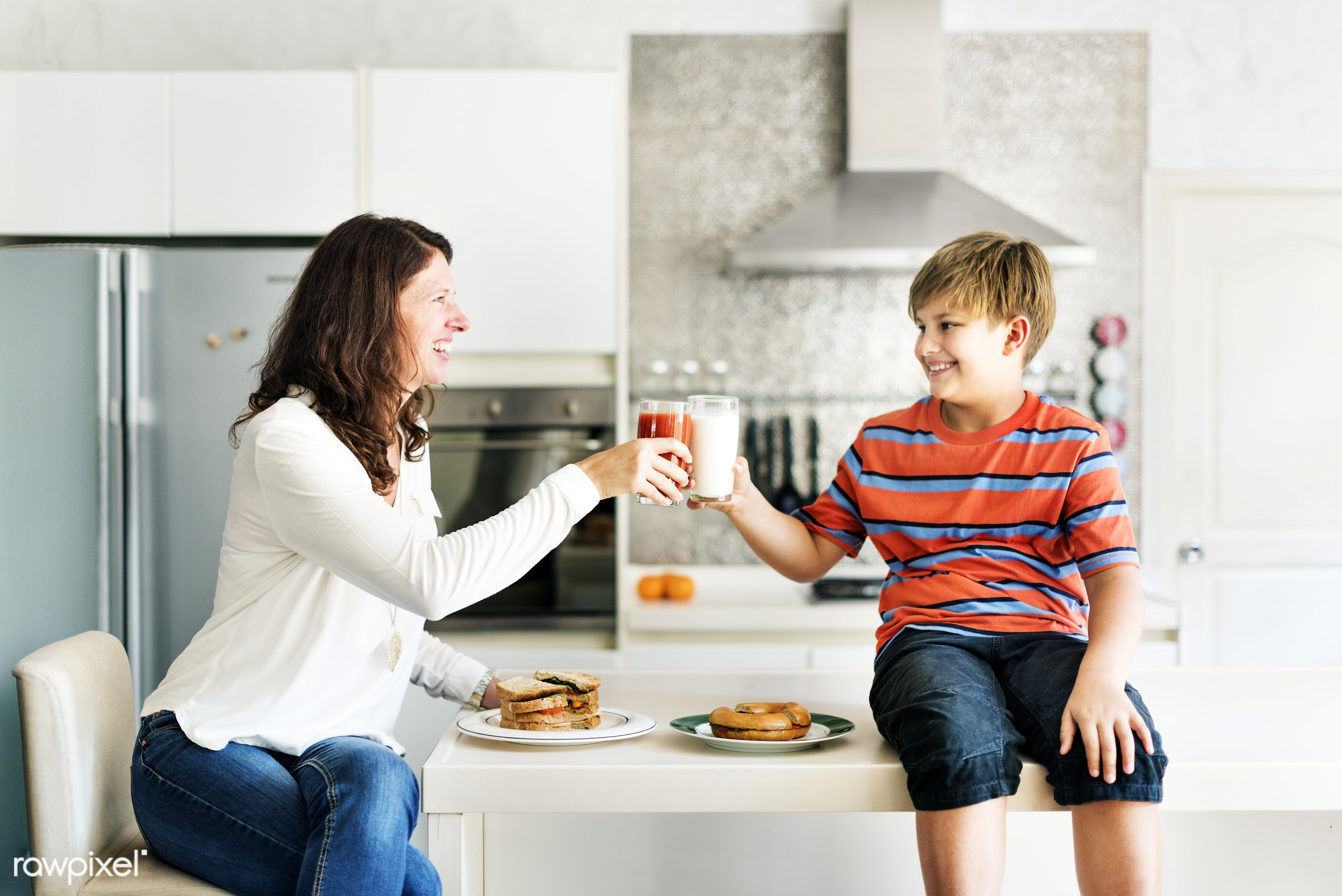 Daily lifestyle of caucasian family shoot - breakfast, boy, cheerful, child, eat, eating, enjoy, family, food, happiness,...