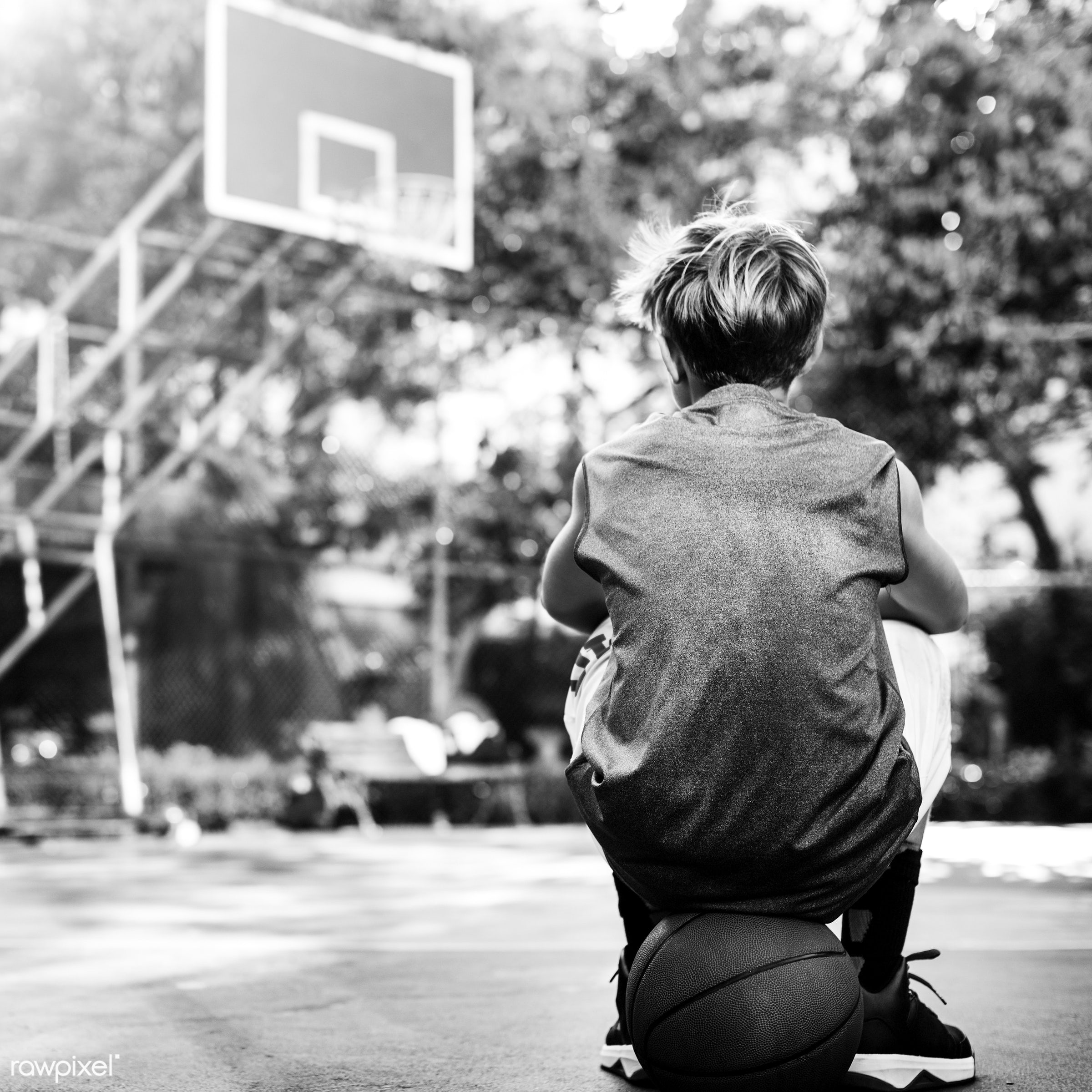 Young basketball player shoot - sport, basketball, activity, ball, boy, exercise, game, man, play, player, practice, rear,...