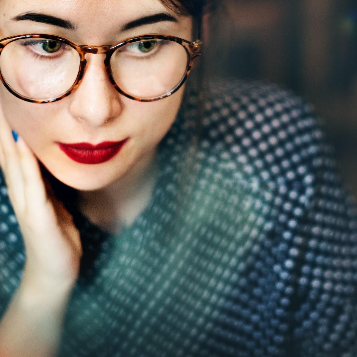 Closeup of thougtful woman wearing eyeglasses portrait