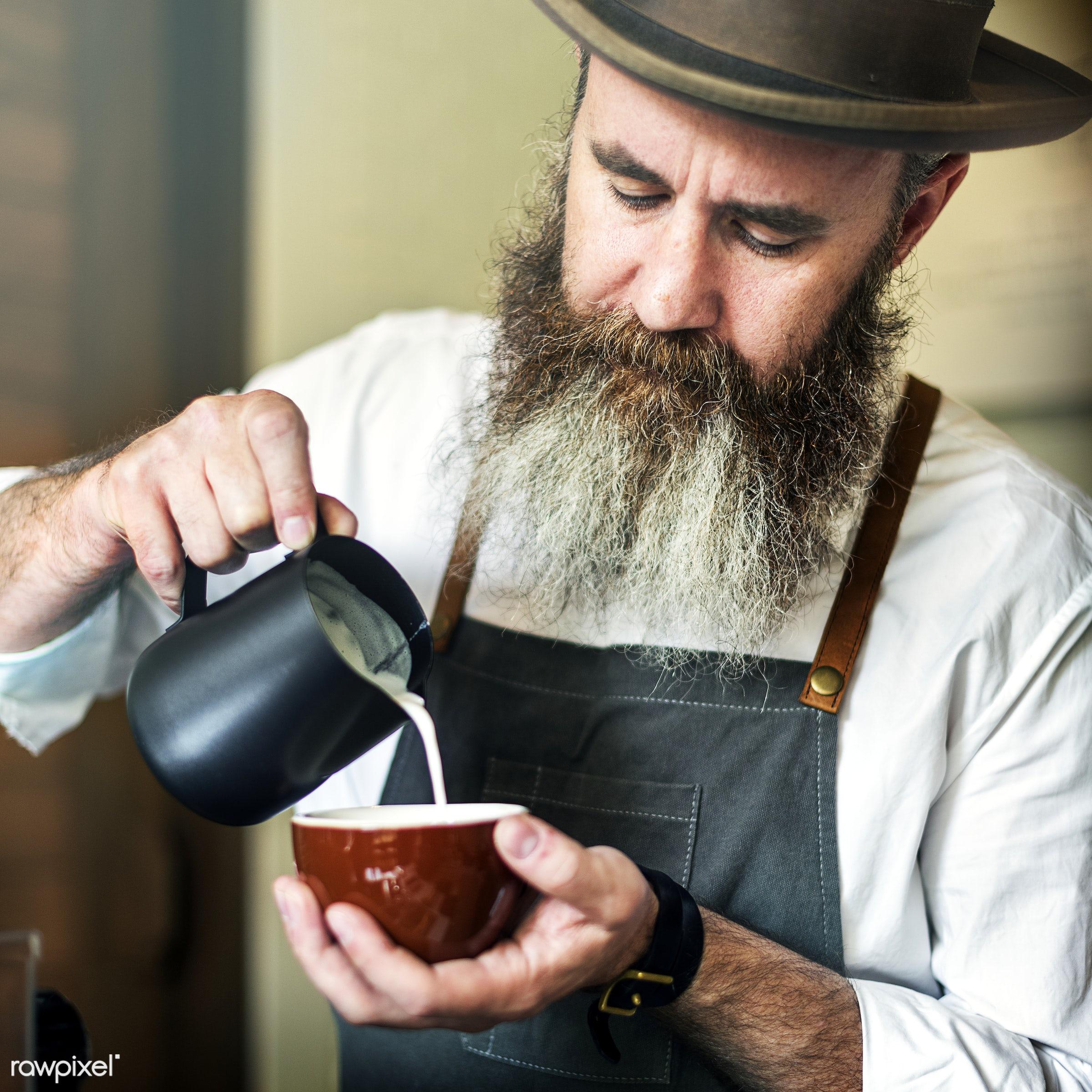 Male barista preparing a cup of coffee - coffee, cafe, restaurant, milk, latte, counter, bar, waiter, apron, barista,...