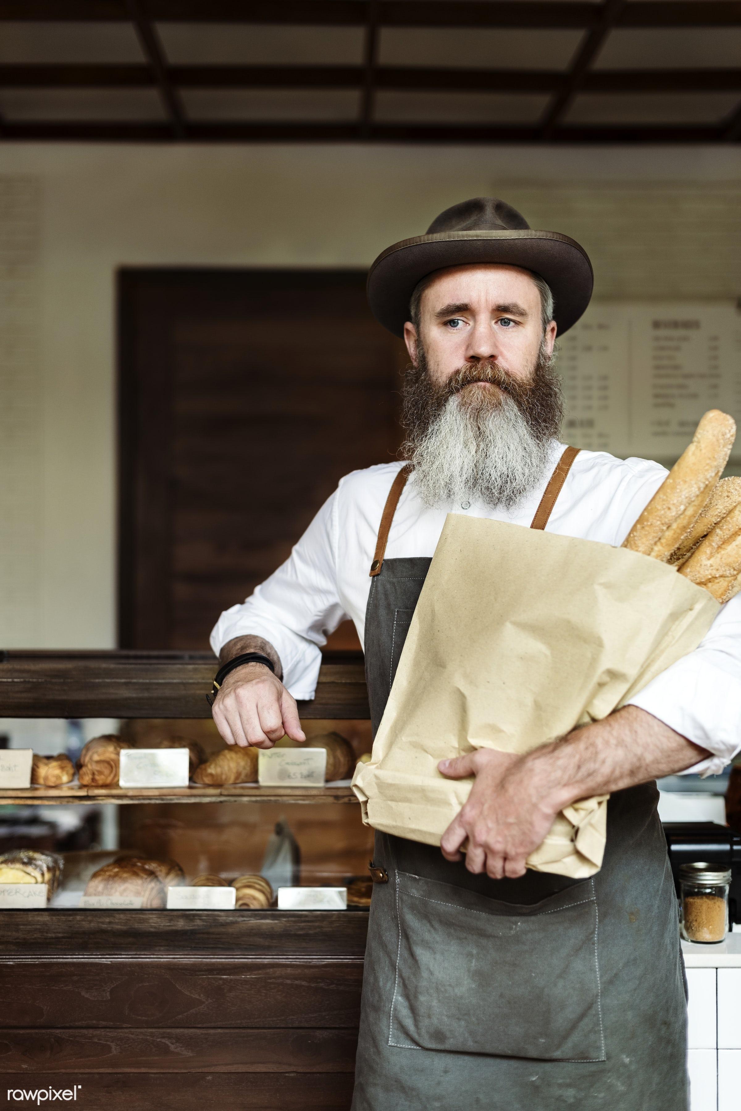 Caucasian barista man at coffee shop - apron, baguette, barista, beverage, bread, career, caucasian, cheerful, coffee,...