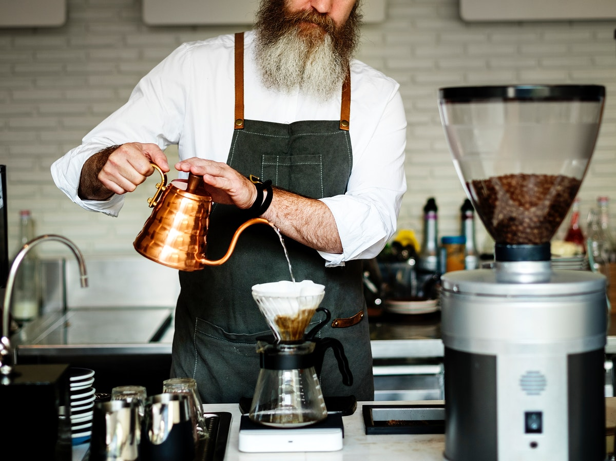 Caucasian barista man making drip coffee