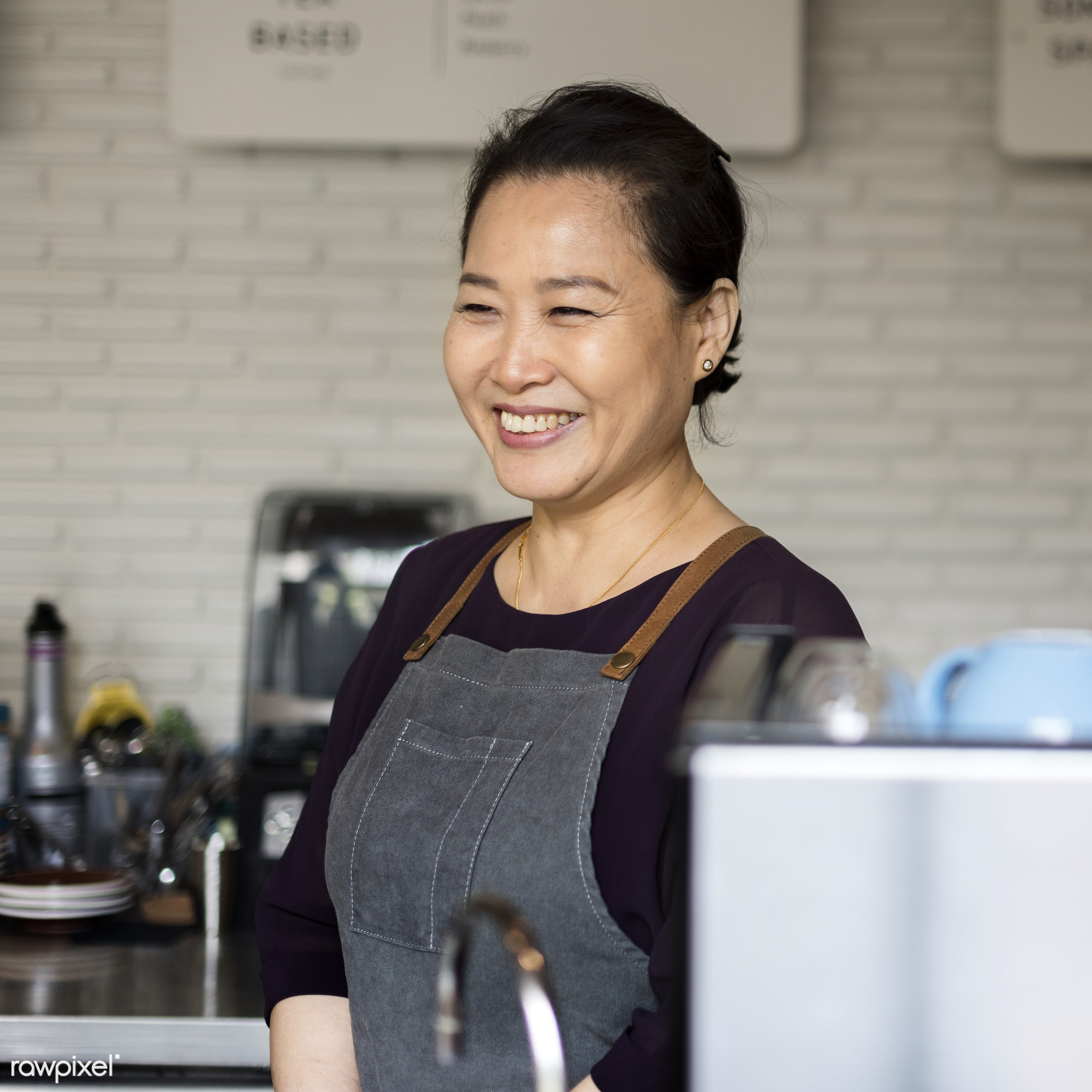 Asian barista woman at coffee shop - alone, apron, asian, barista, beverage, career, cheerful, coffee, coffee shop, one,...