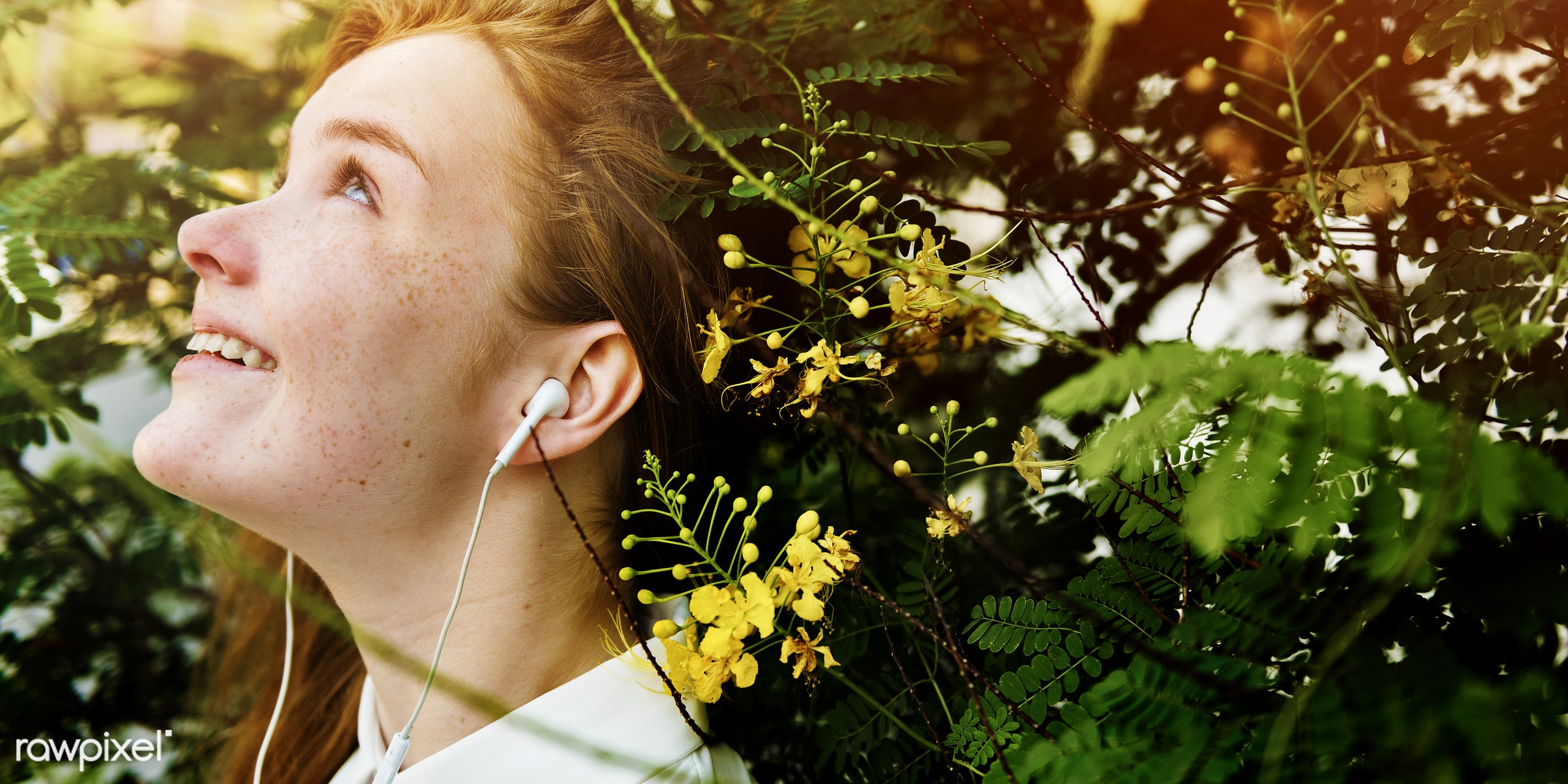 Young caucasian woman is listening to music - listen, side, young, alone, cheerful, closeup, earphones, entertainment,...