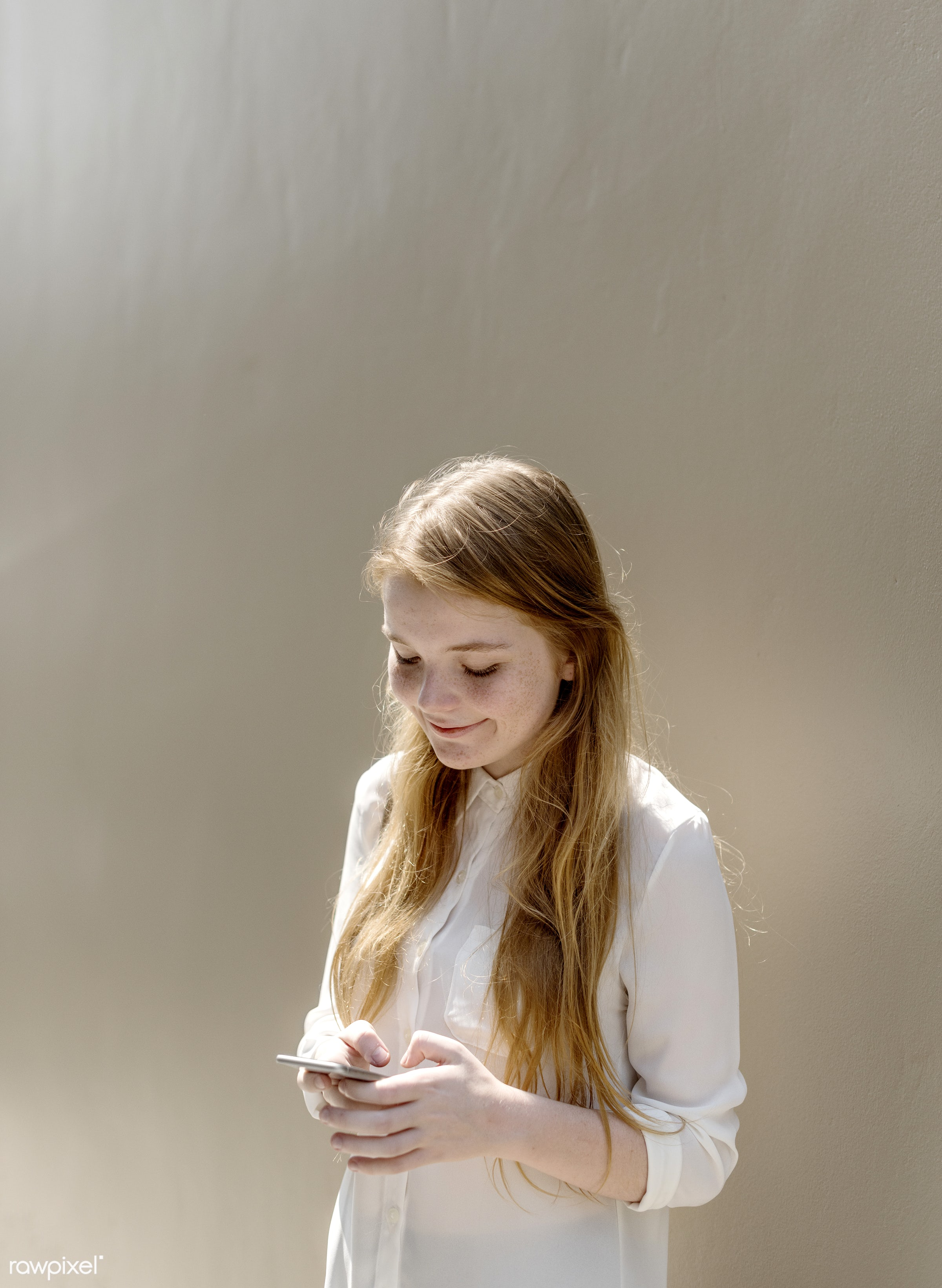Girl Browsing Phone Connection Concept - mobile phone, face, girl, alone, cellphone, cheerful, communication, connection,...