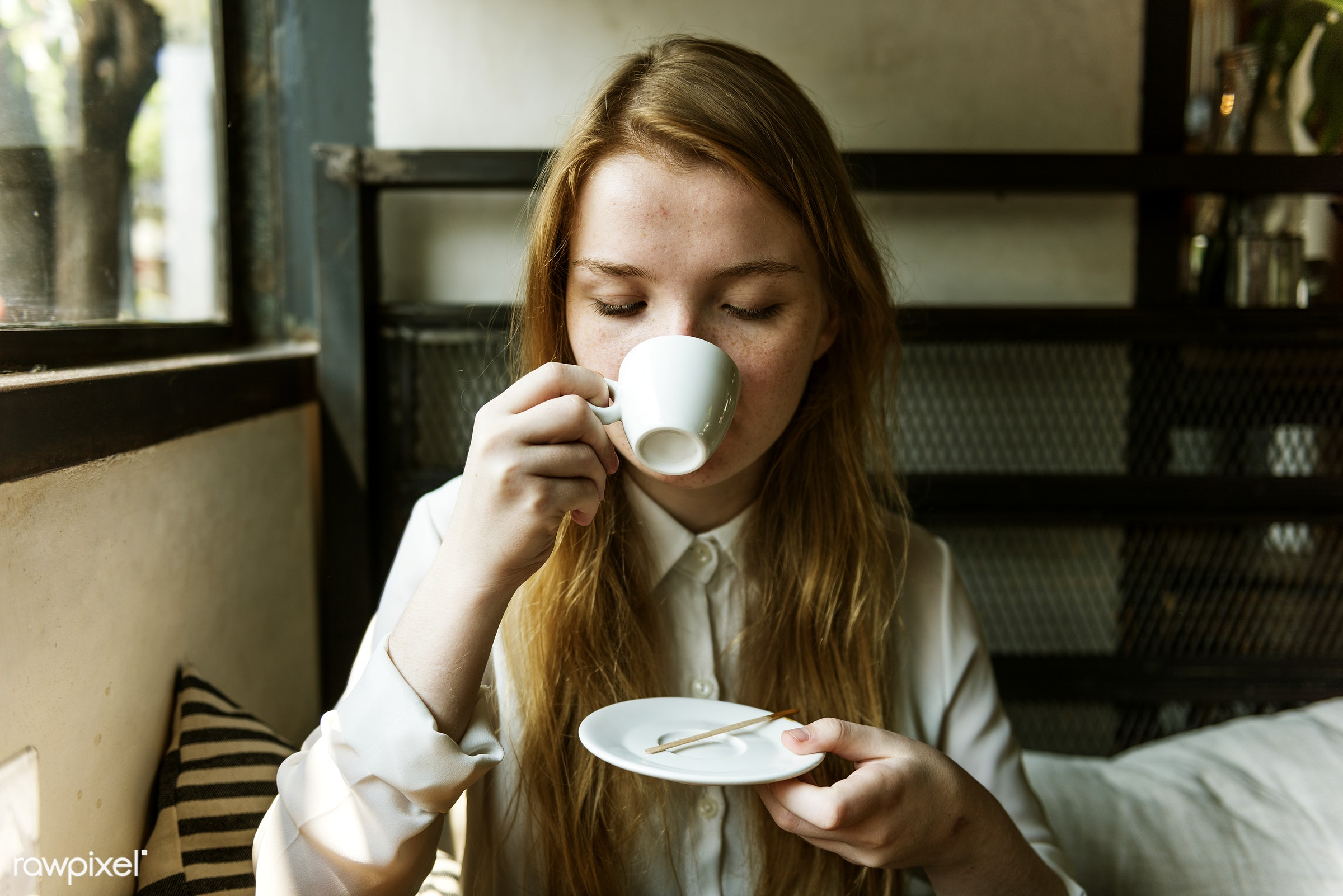 Young caucasian woman at a coffee shop - coffee, alone, aroma, beverage, break, cafe, caffeine, cheerful, coffee break,...