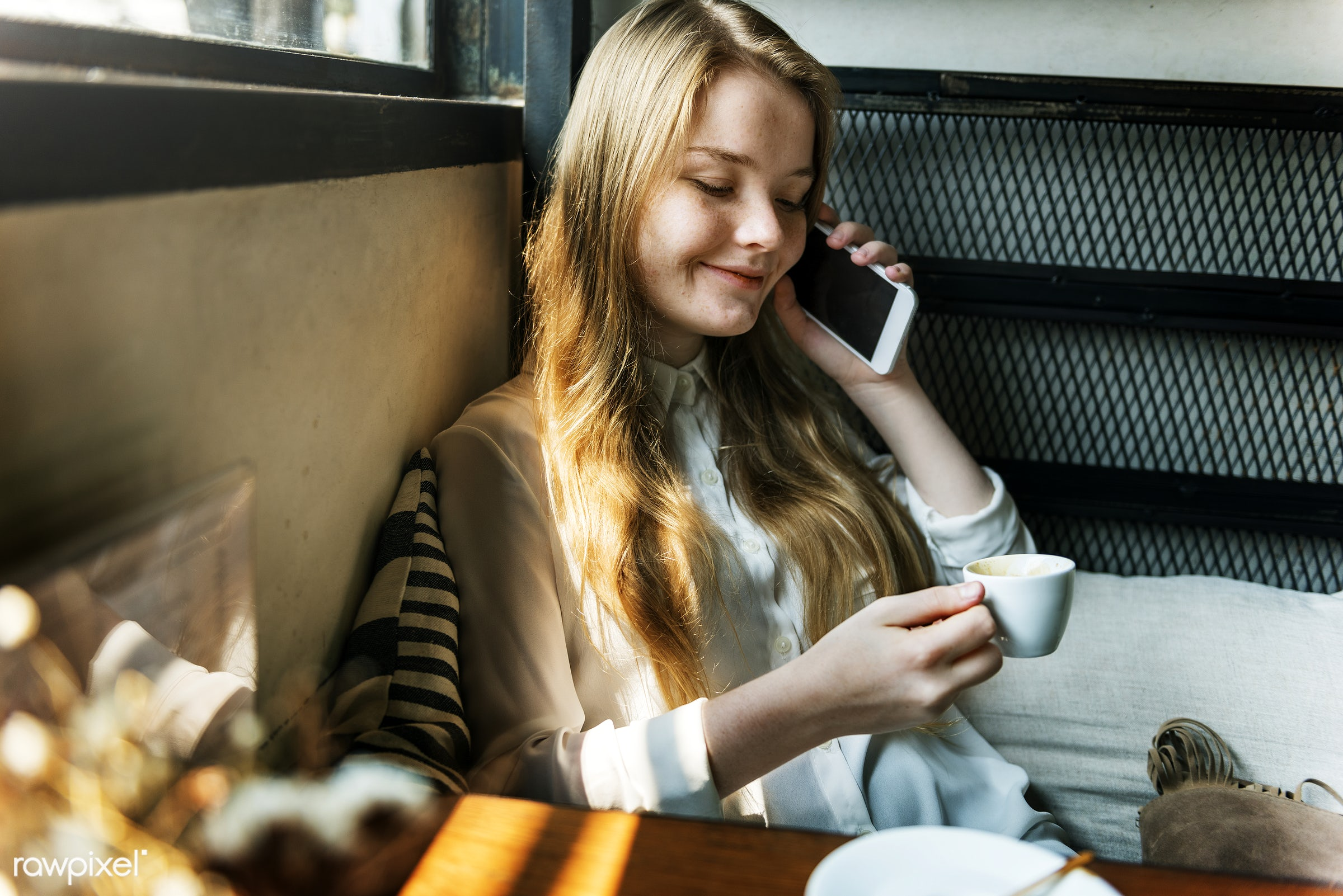Young caucasian woman at a coffee shop - alone, aroma, beverage, break, cafe, caffeine, cellphone, cheerful, coffee, coffee...