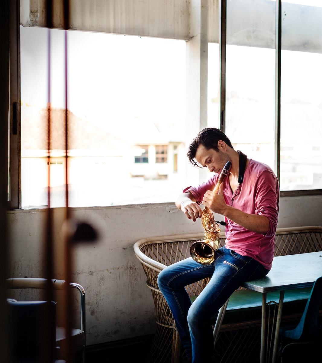Man tuning saxophone