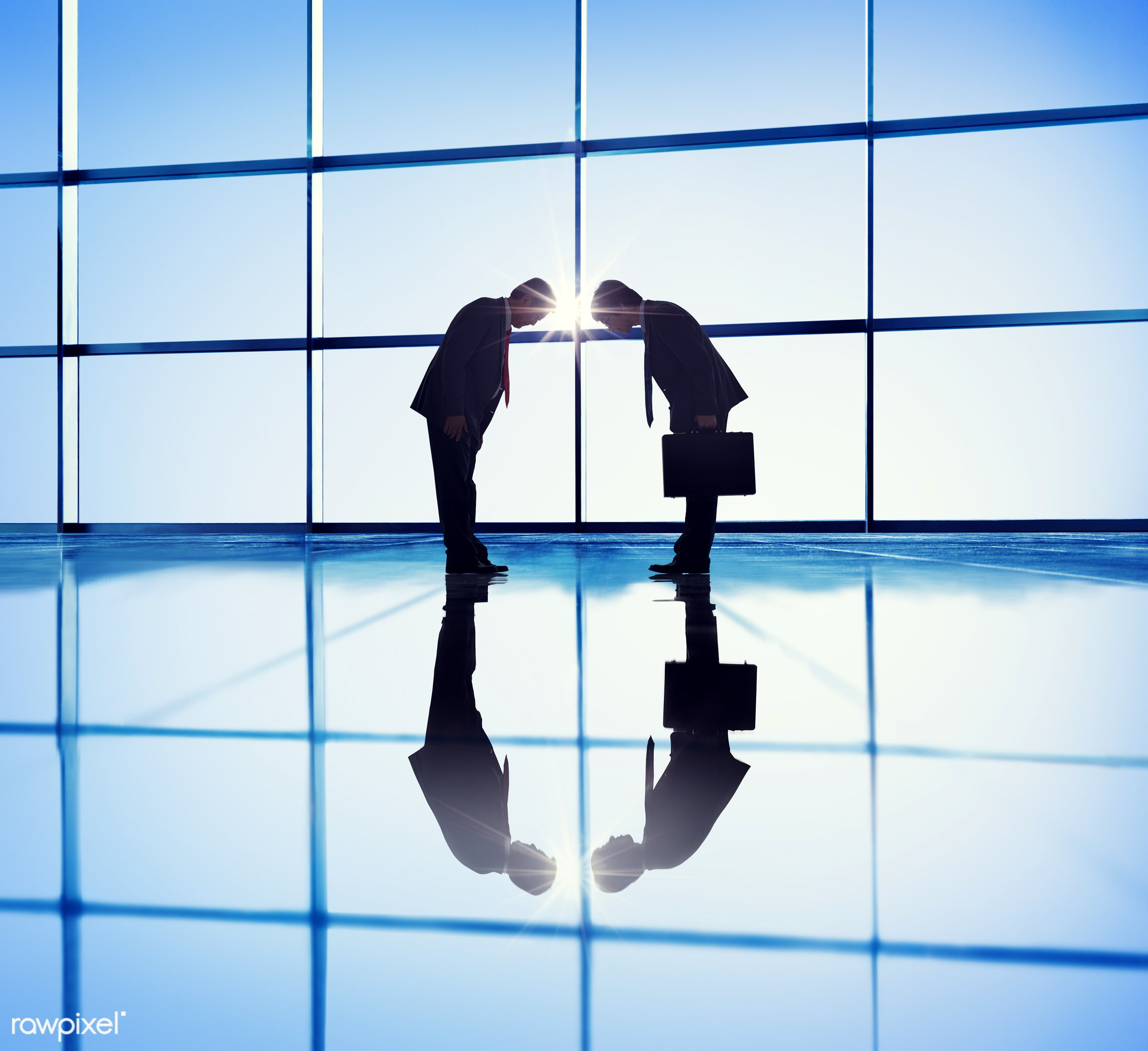 Two businessmen bowing in respect - china, japan, achievement, adult, agreement, asian, back lit, bowing, briefcase,...