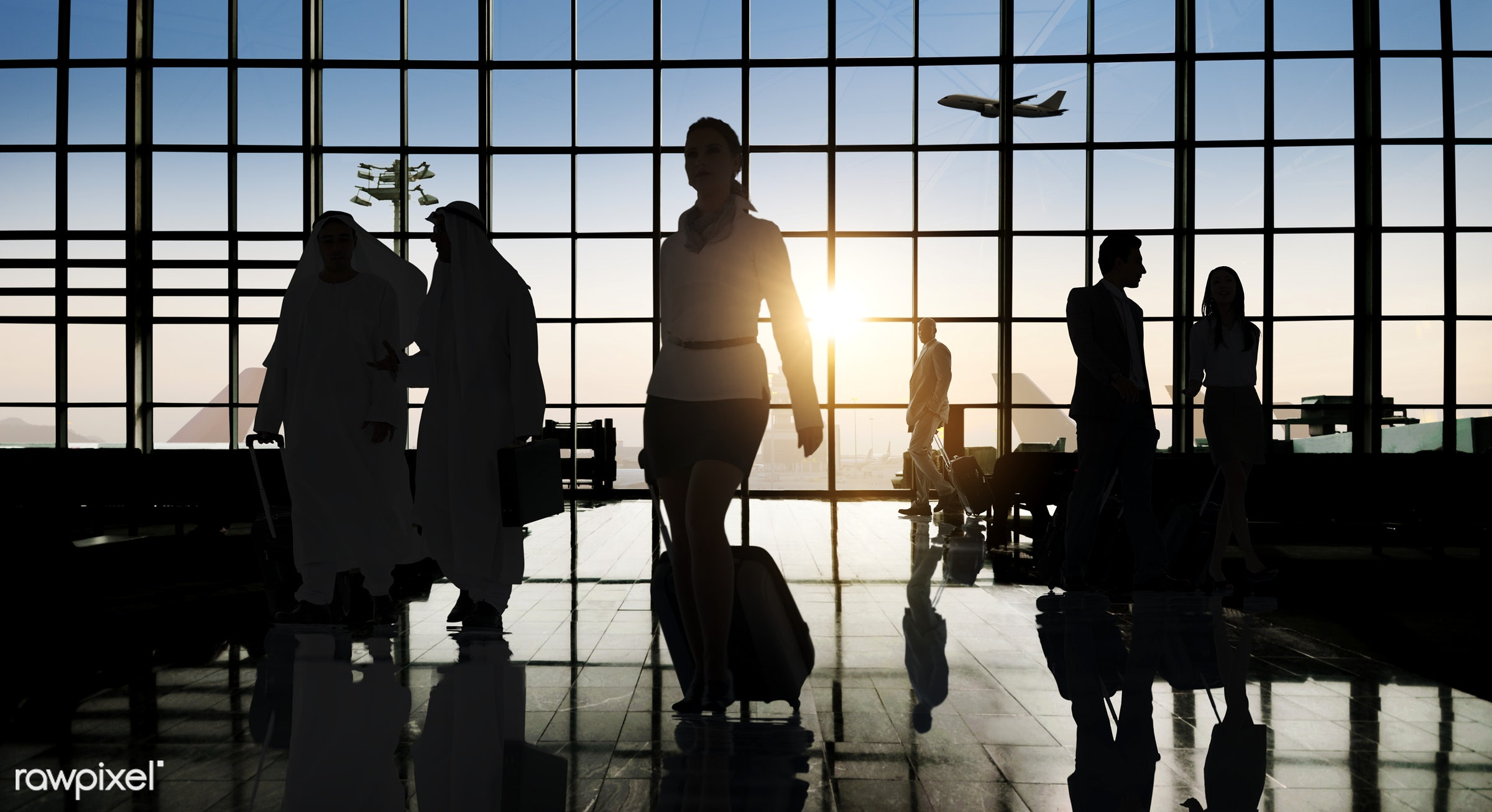 Corporate business travel - airplane, airport, back lit, building, business, business people, business travel, businessmen,...