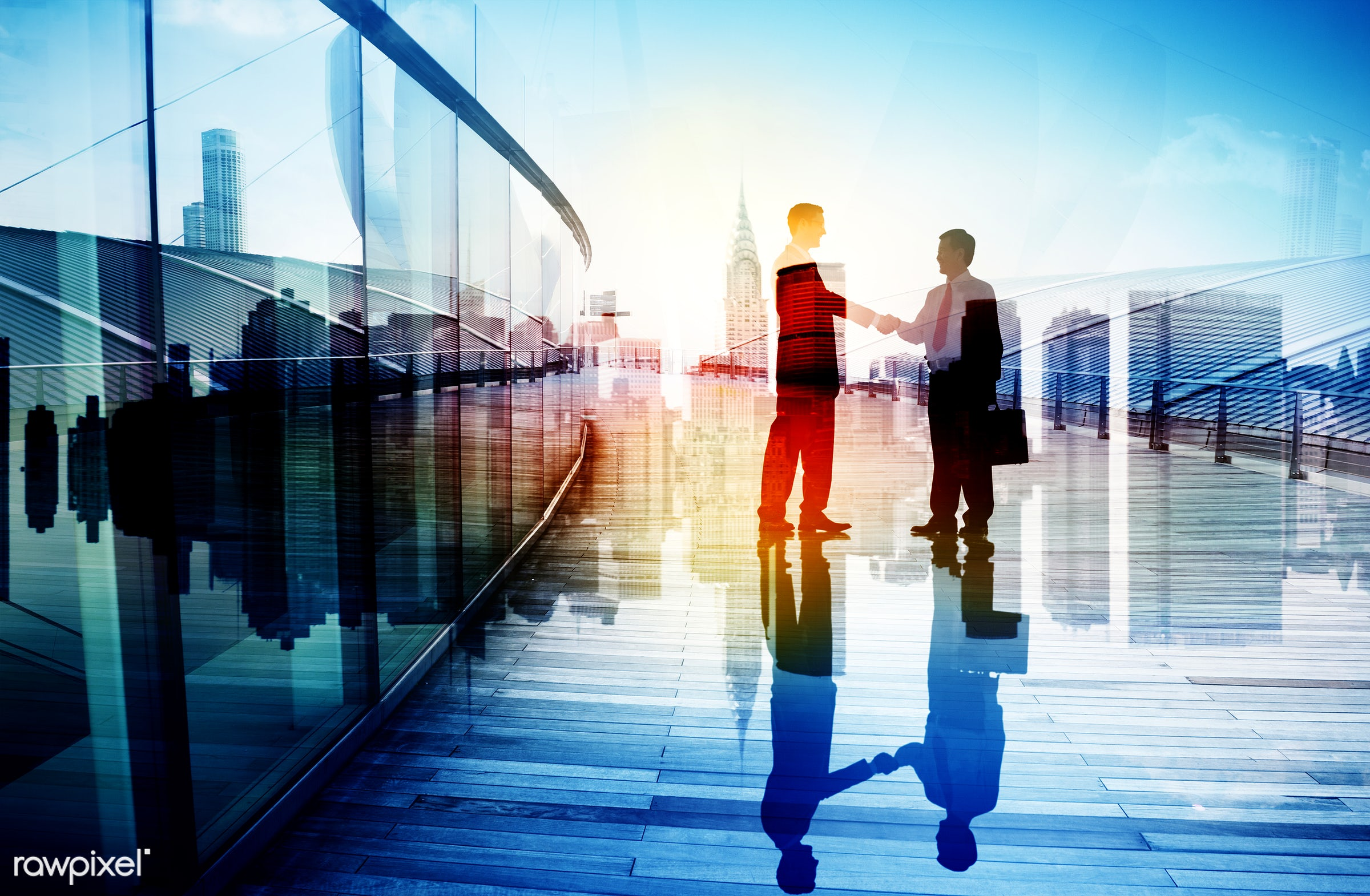 Business partners shaking hands - achievement, agreement, back lit, building, business, business people, businessmen,...