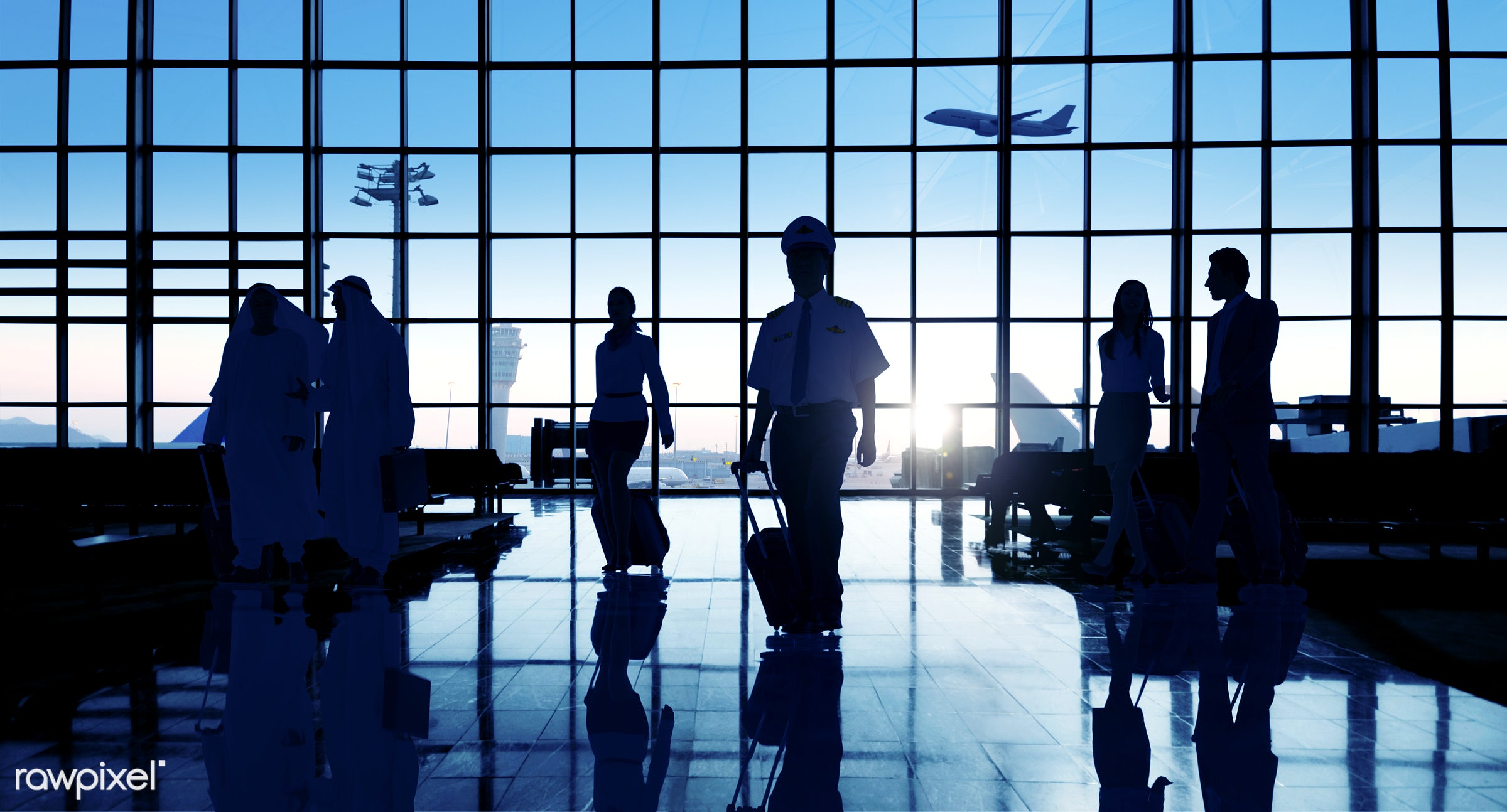 Business people traveling from an airport - airplane, airport, back lit, building, business, business people, business...