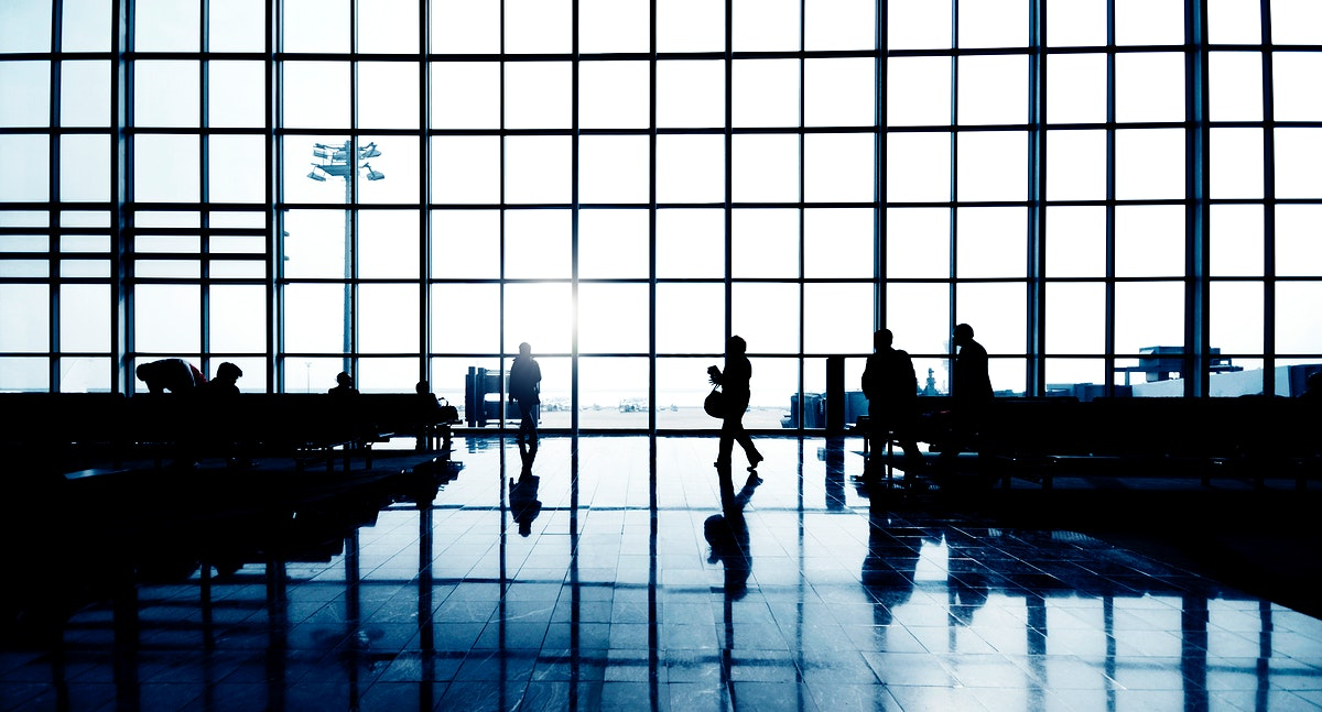 Silhouettes of people walking at the airport