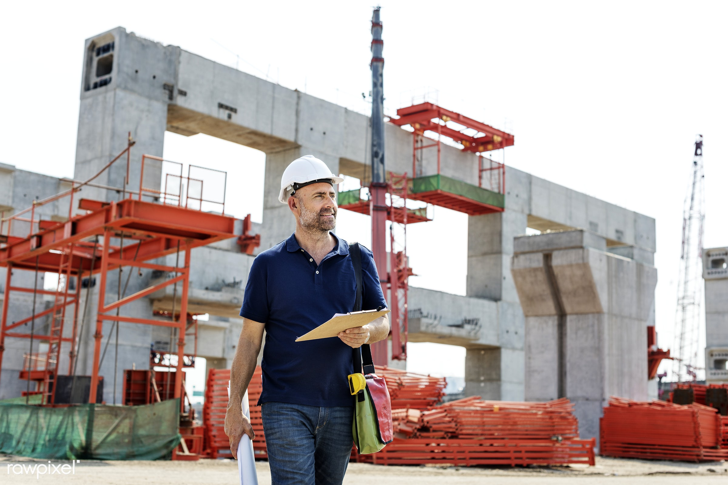 Site engineer on a construction site - construction, building, engineering, architecture, blueprint, board, built, career,...