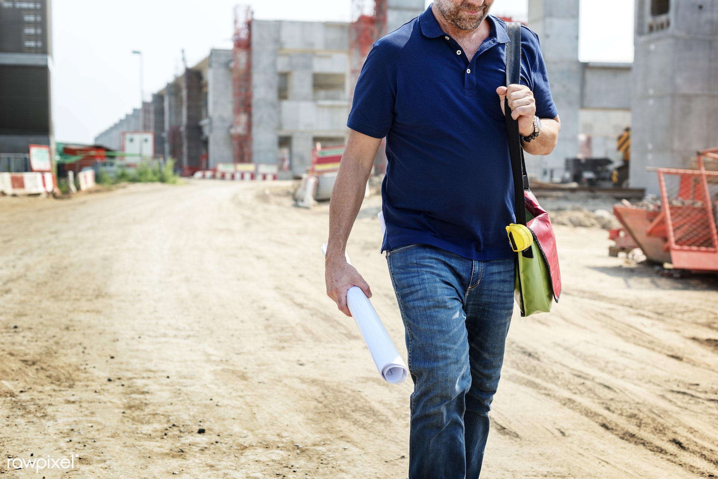 Site engineer on a construction site - construction, worker, plan, architecture, blueprint, board, building, built, career,...