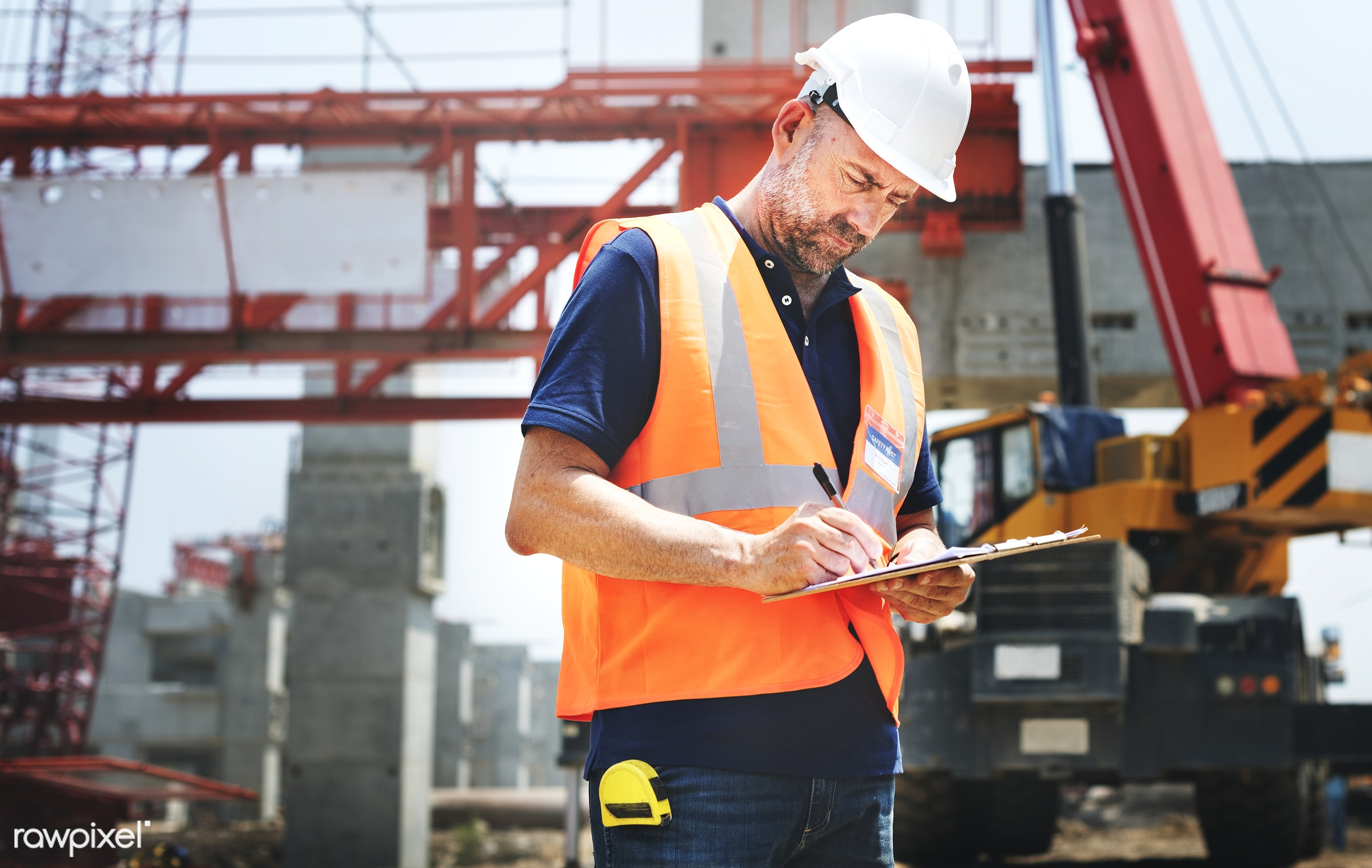 Site engineer on a construction site - construction, worker, safety, career, quality, architecture, blueprint, board,...
