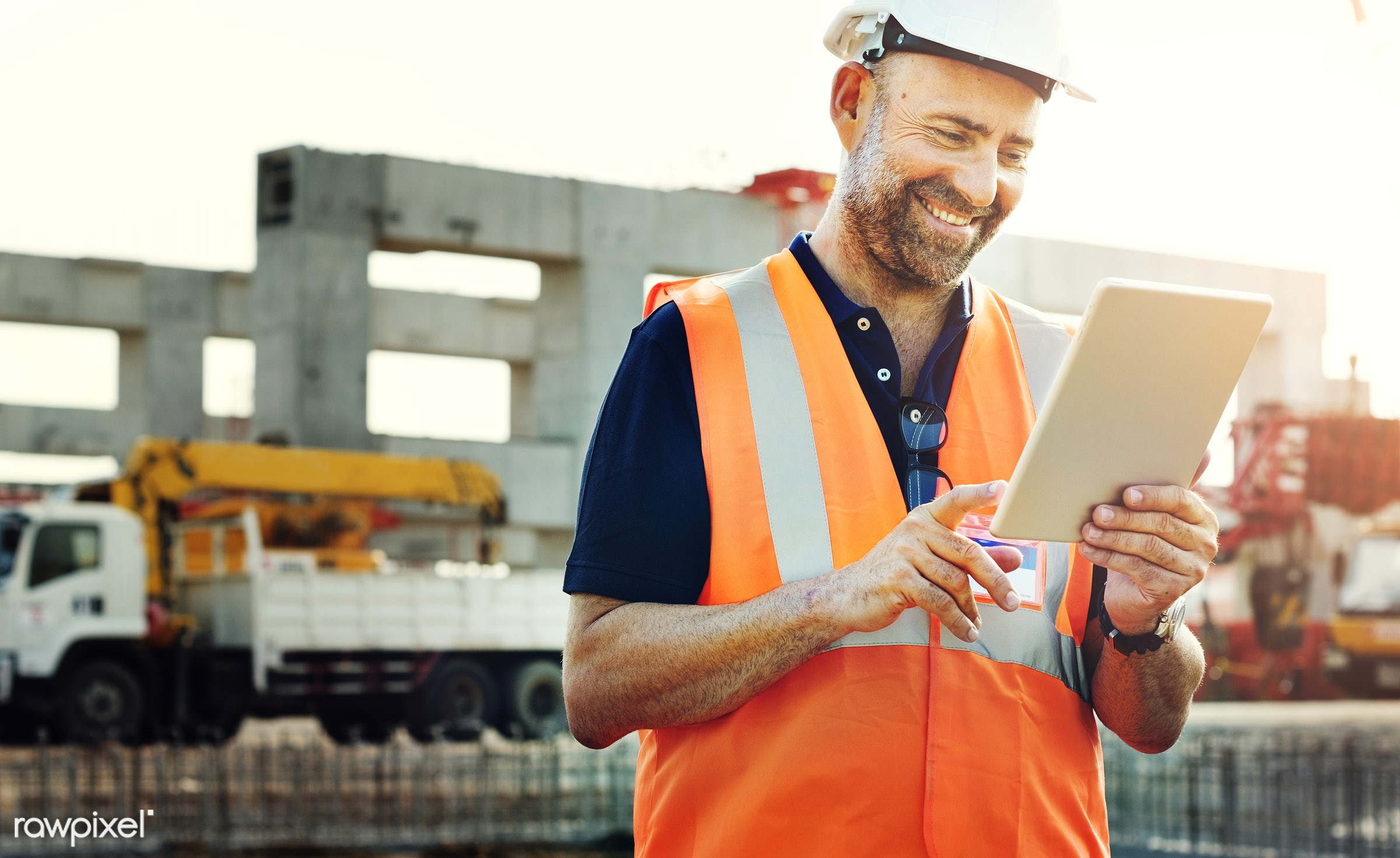 Site engineer on a construction site - construction, worker, engineer, tablet, technology, safety, construction site,...