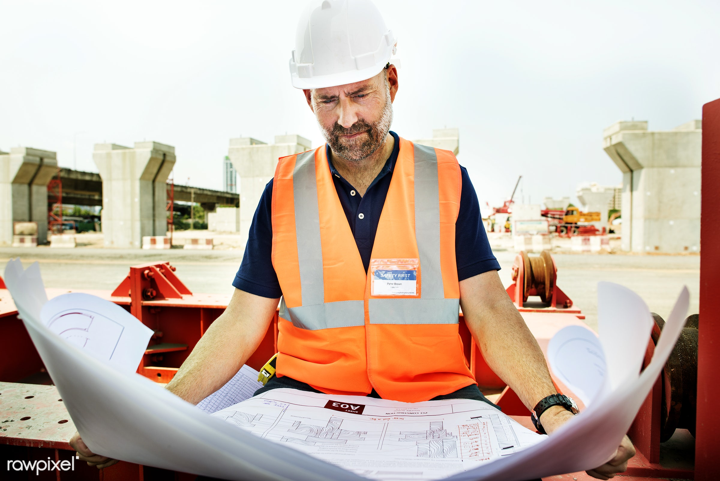 Site engineer on a construction site - engineer, architecture, blueprint, building, built, career, check, construction,...