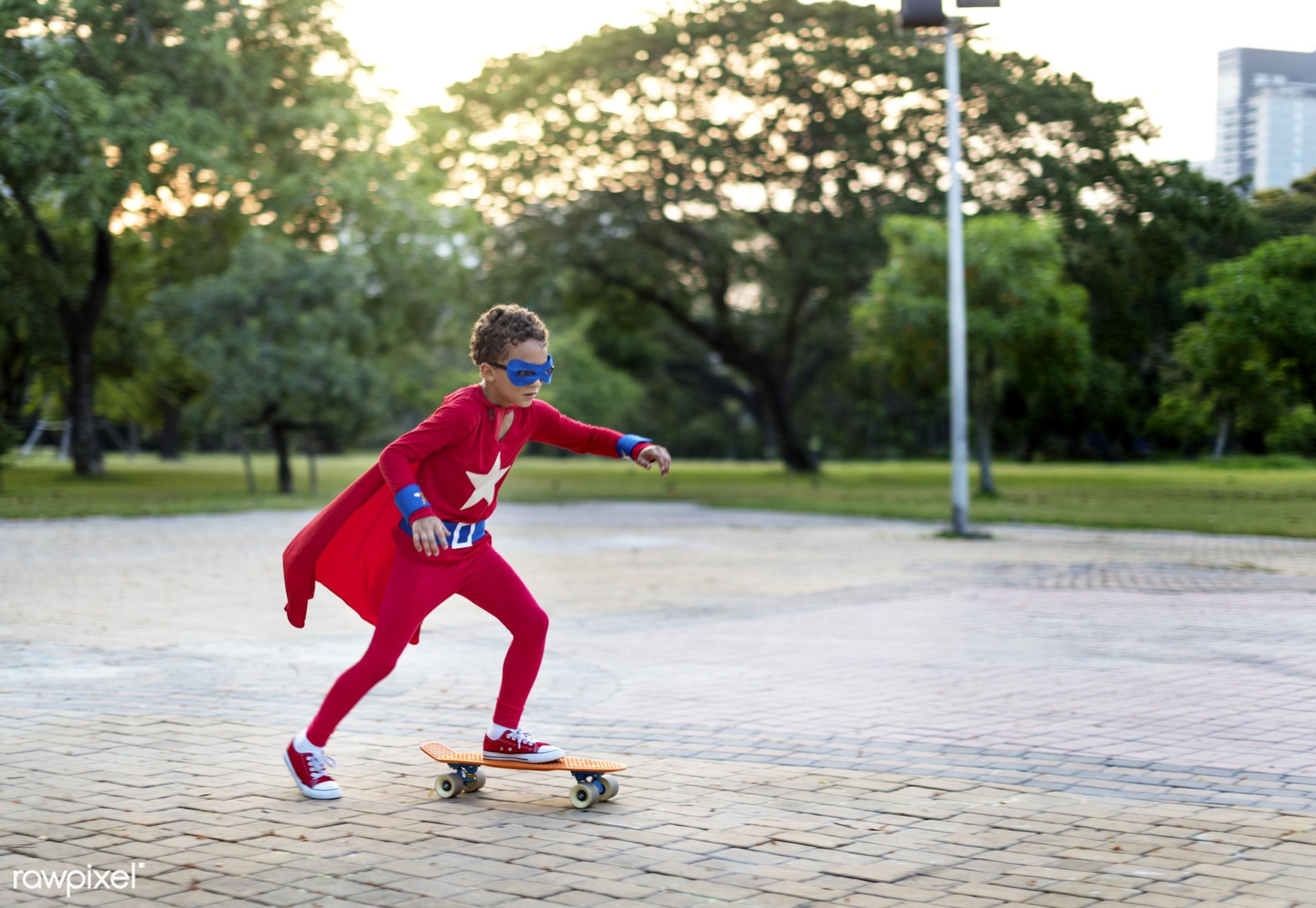 Superhero boy on a skateboard - hero, game, superhero, activity, aspirations, boy, brave, cheerful, child, childhood,...