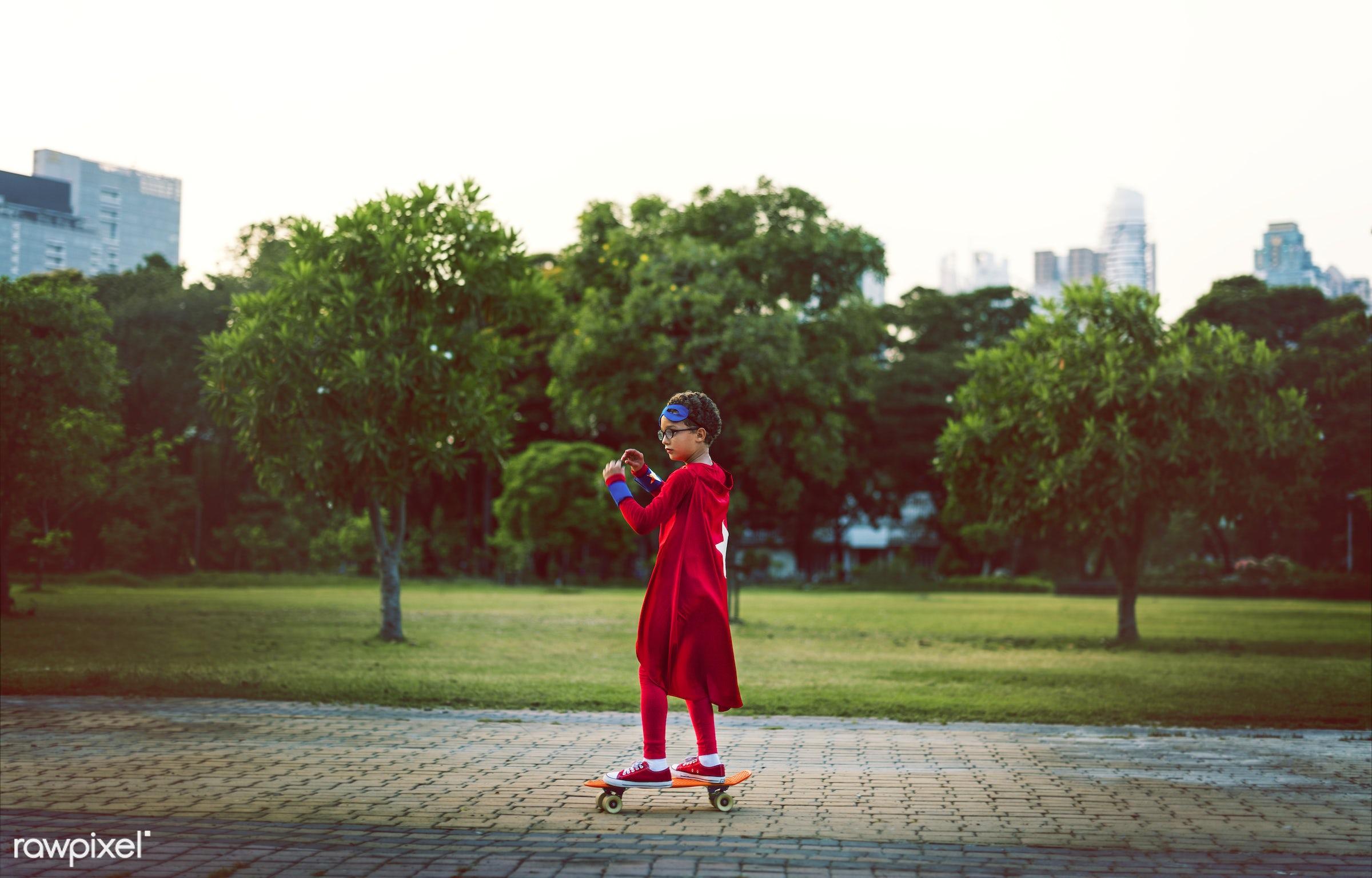 Superhero boy on a skateboard - superhero, costume, action, activities, aspiration, boy, casual, cheerful, child, childhood...