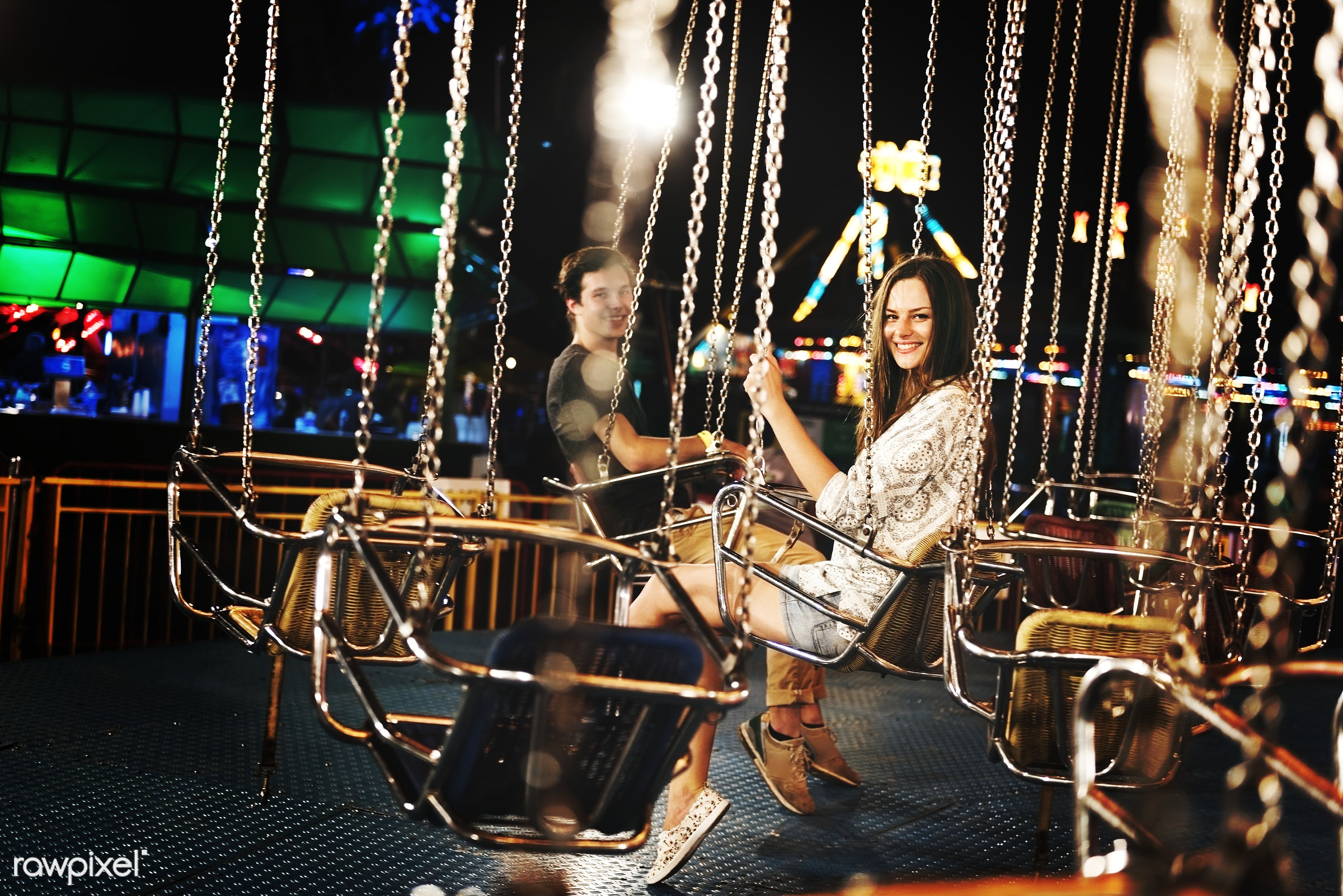 A group of friends is enjoying the amusement park - amusement park, caucasian, enjoyment, expression, feeling, friends,...