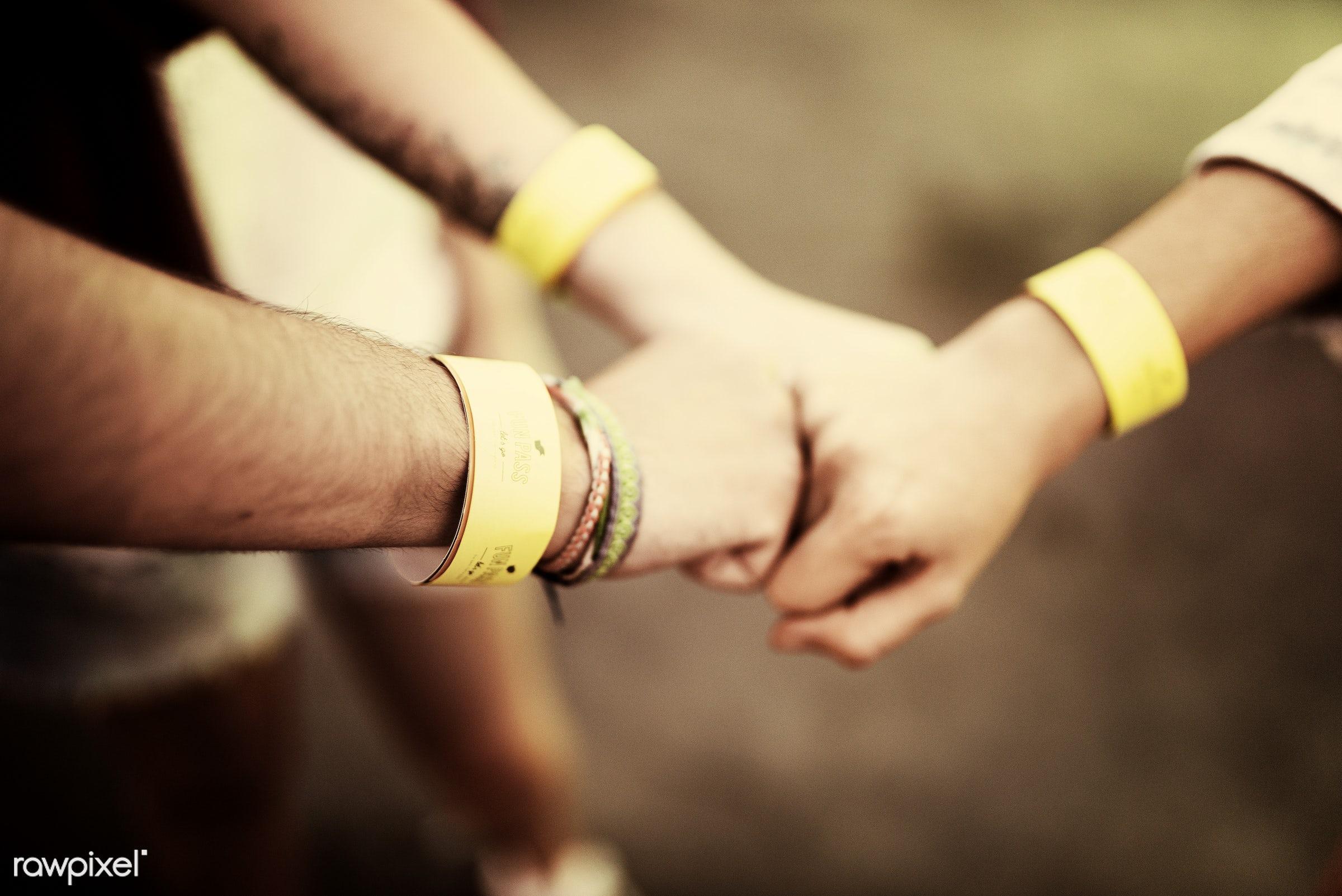 amusement park, band, bump, closeup, enjoyment, expression, fists, friends, friendship, fun park, group, hands, people,...