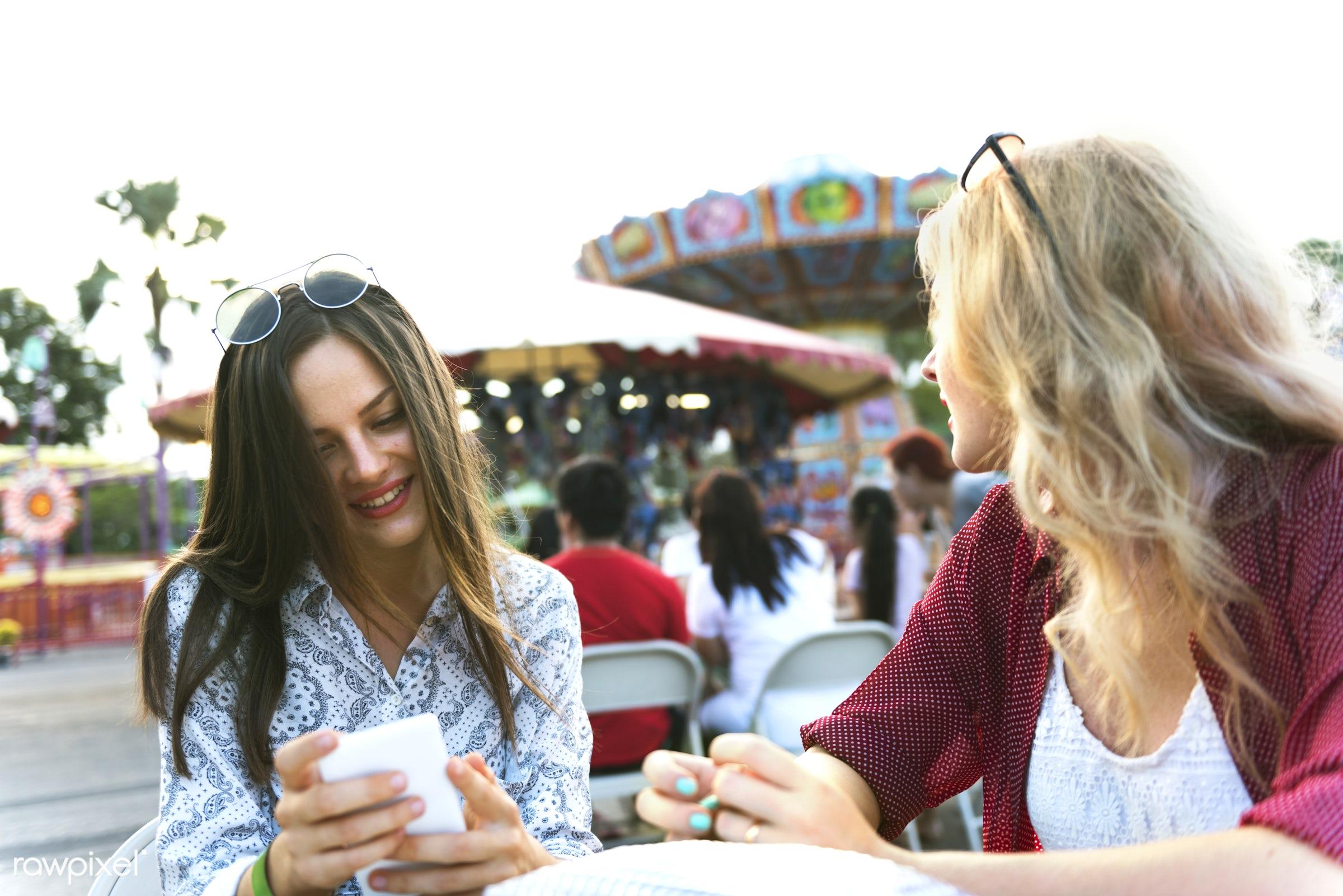 A group of friends is enjoying the amusement park - amusement park, cellphone, couple, dating, device, digital, enjoyment,...