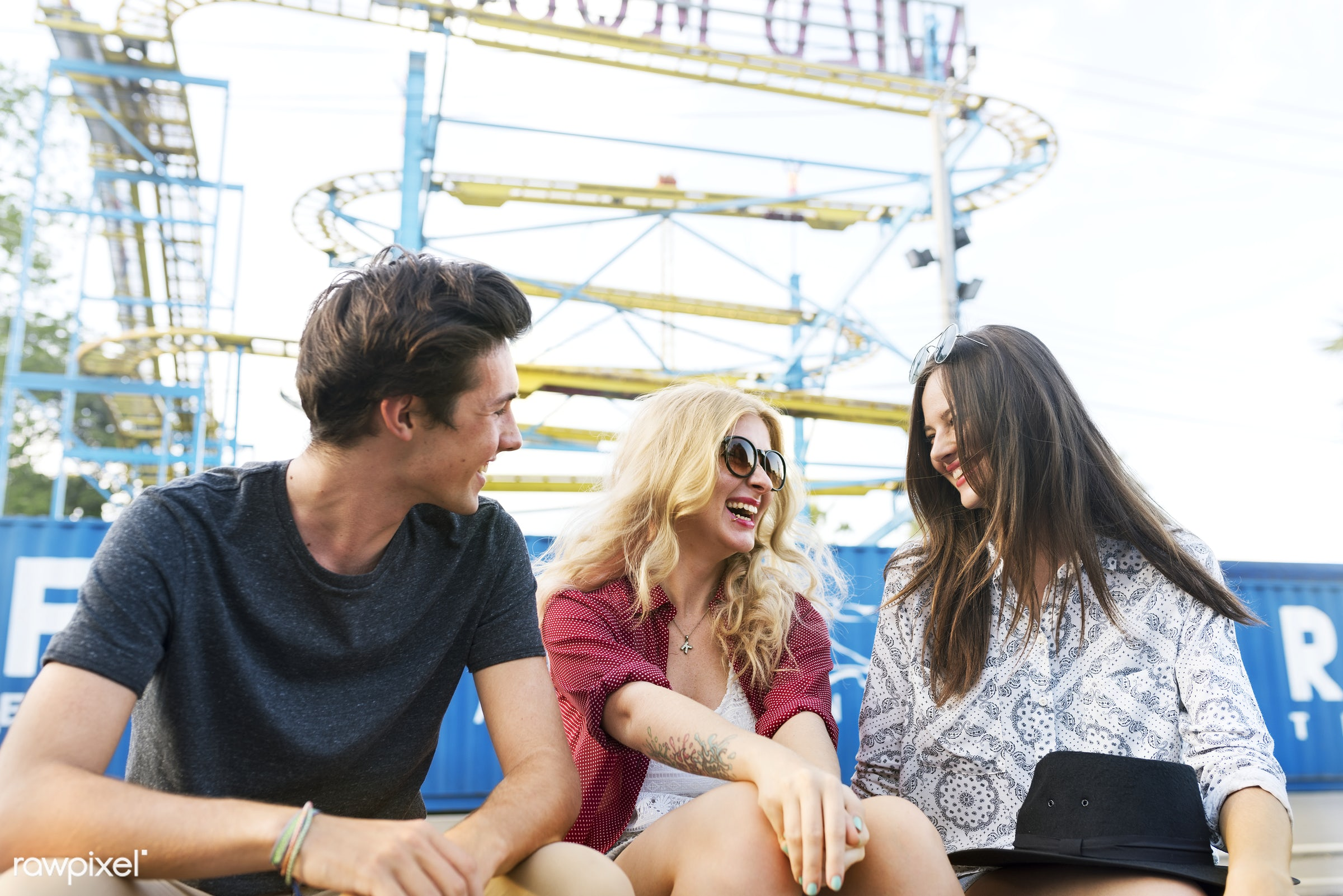 A group of friends is enjoying the amusement park - amusement park, conversation, enjoyment, expression, feeling, friends,...